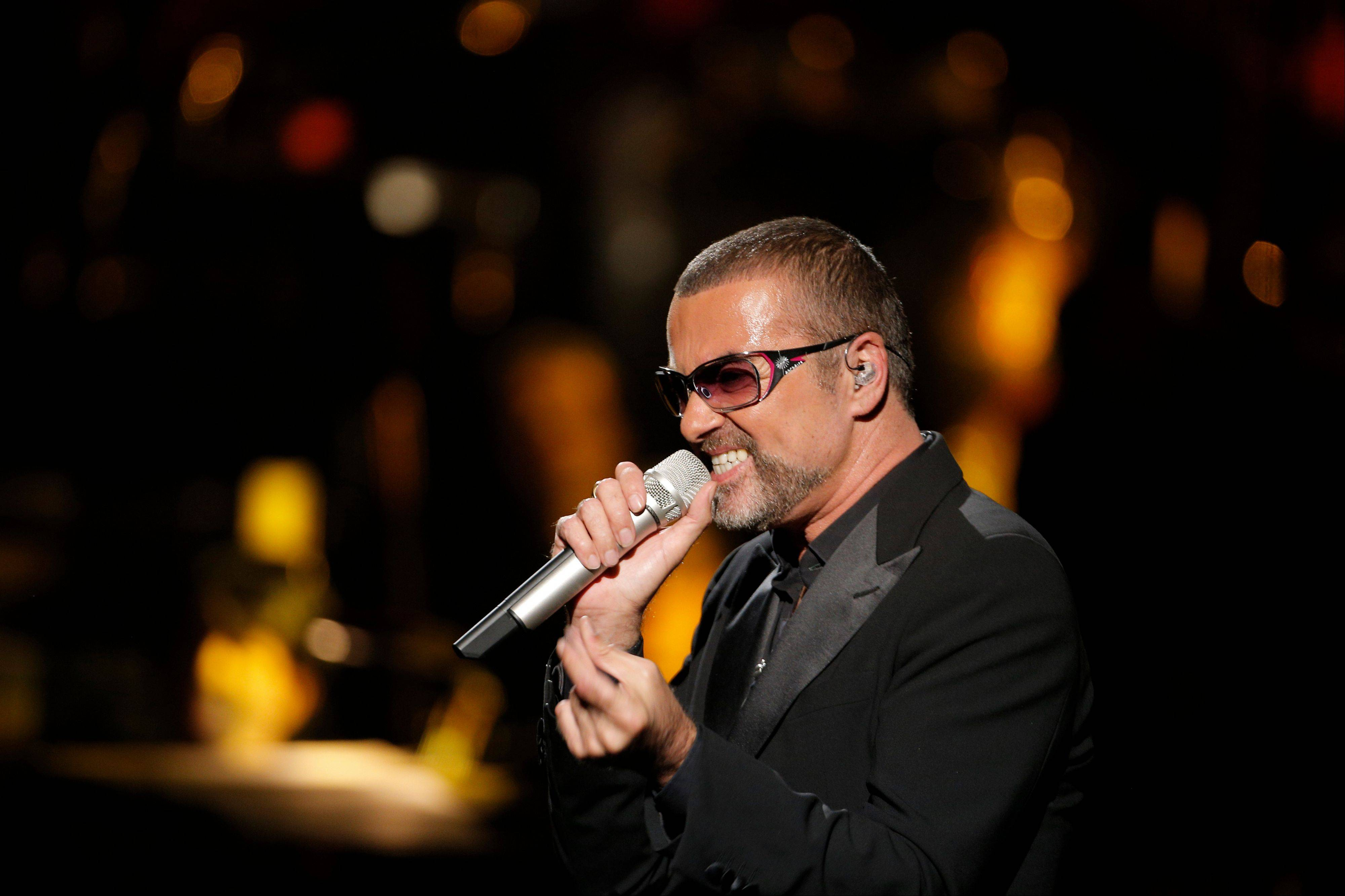 George Michael's publicist says the singer is being treated for minor injuries after he was a passenger in a car crash Thursday night.