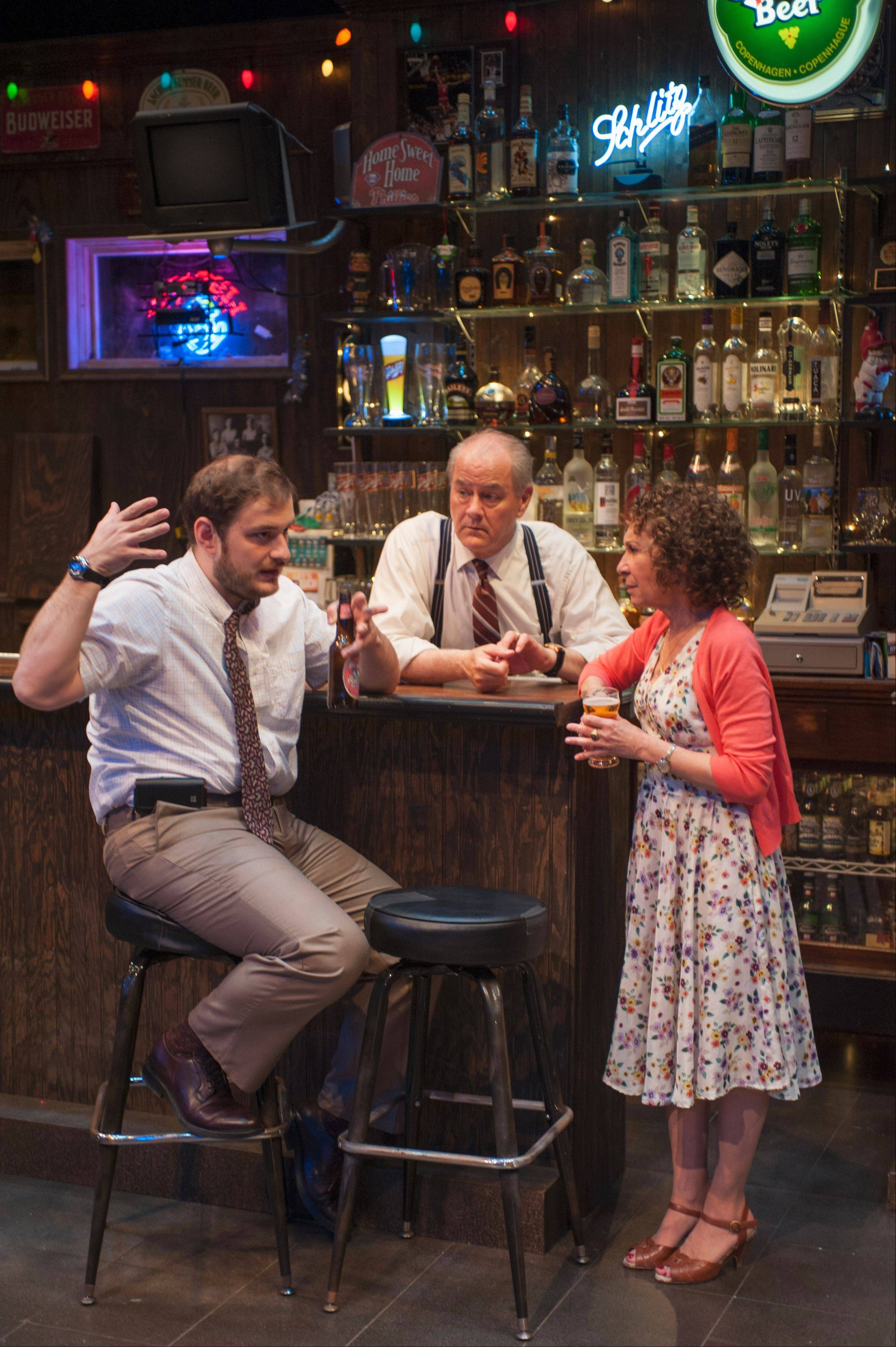 "Newly engaged Donnie (Ed Flynn, left) seeks confirmation from bar owner Lou (Francis Guinan, center) and longtime patron Stella (Rhea Perlman) that he's doing the right thing in the world premiere of Bruce Graham's ""Stella & Lou"" at Northlight Theatre in Skokie."