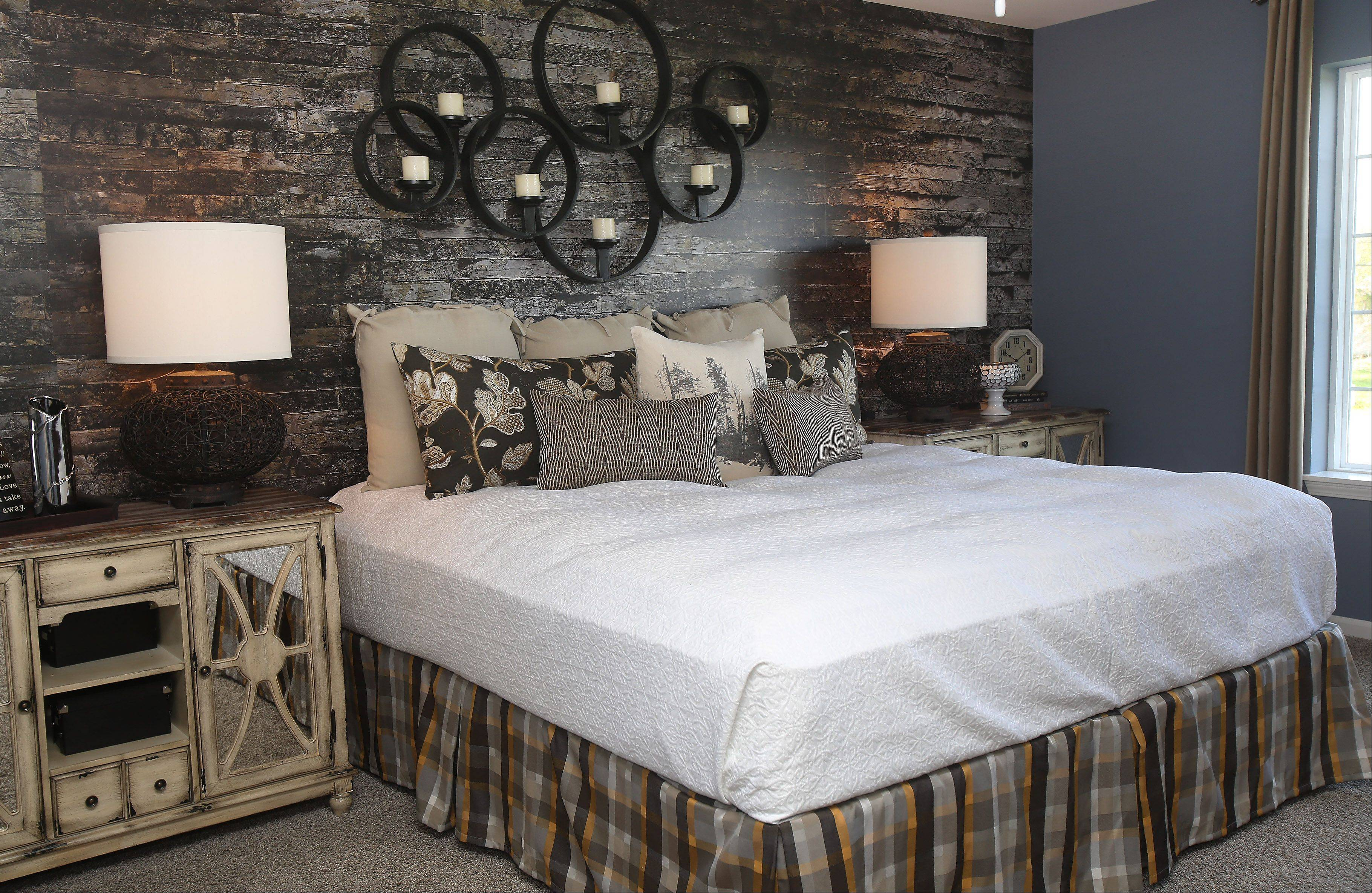 The master bedroom has a rustic flair in the recently opened Tuscan model.