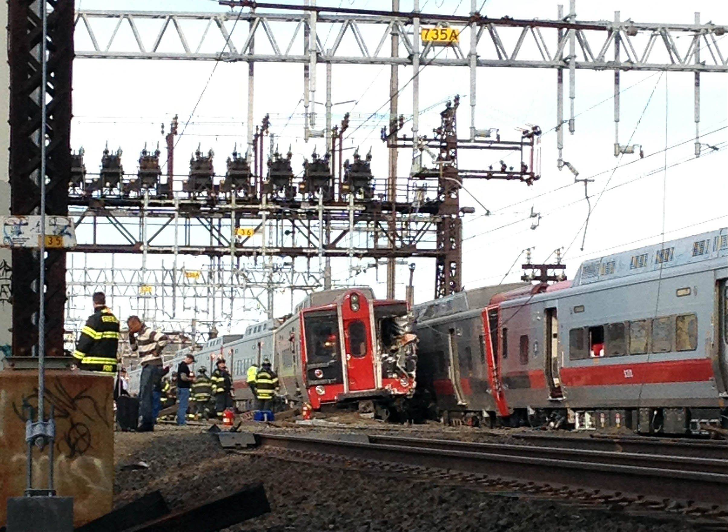 Emergency workers arrive at the scene Friday of a train collision in Fairfield, Conn.
