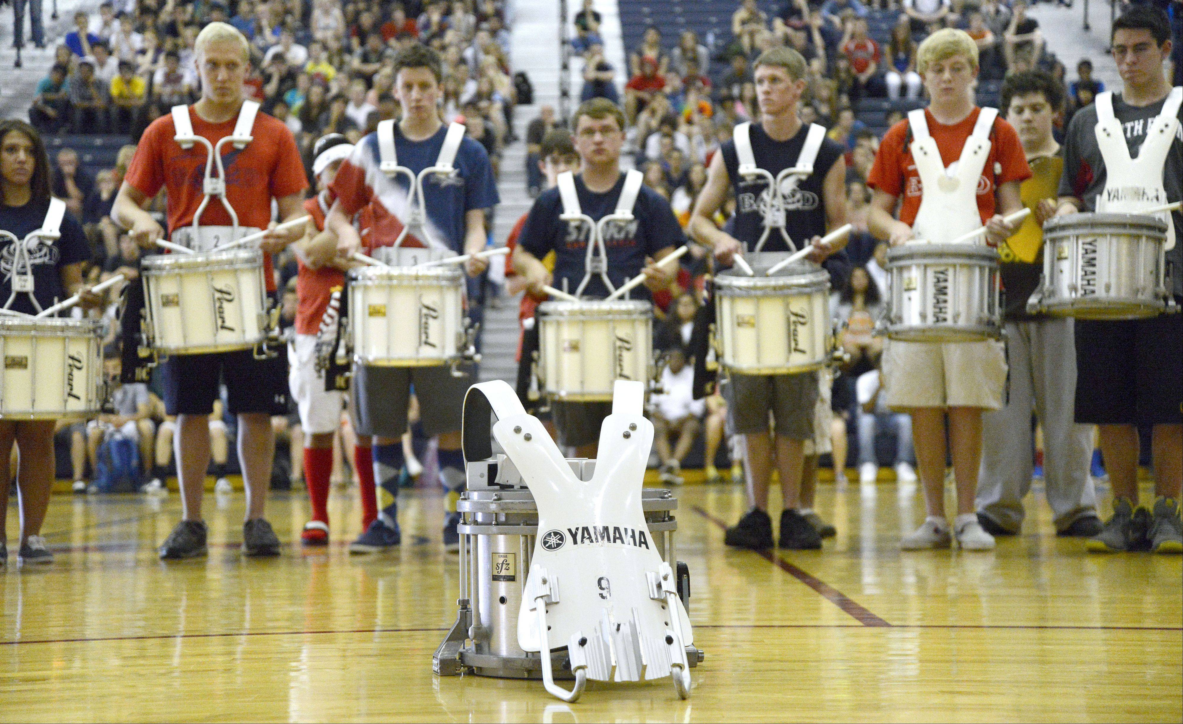 Freshman Rhett Lundy's drum sits in front of the South Elgin High School drum line Friday as they perform a tribute to him in front of his family during an assembly. Rhett died in his sleep Wednesday.