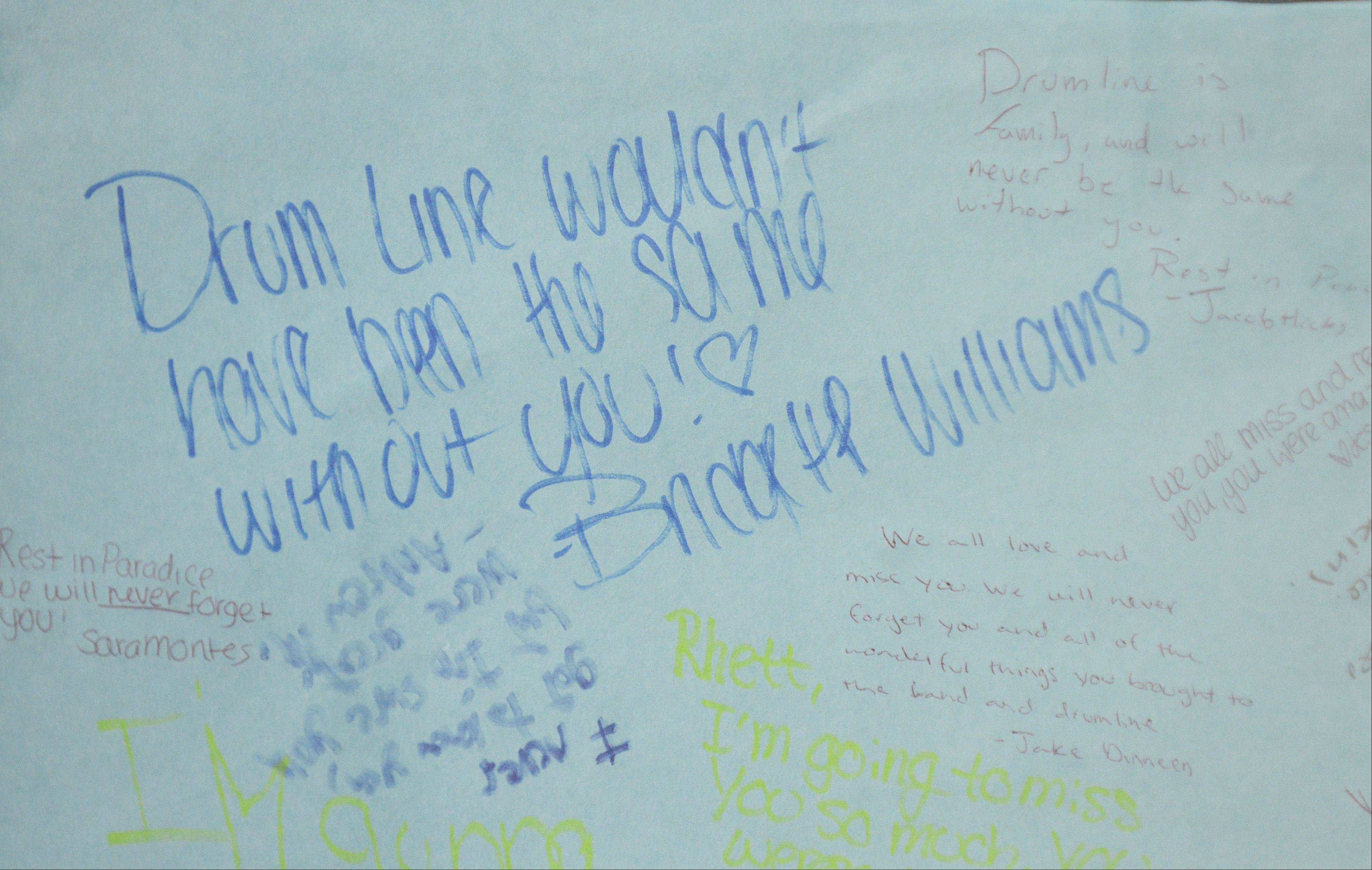 Students express their thoughts on a poster board for South Elgin High School freshman Rhett Lundy, who died Wednesday.