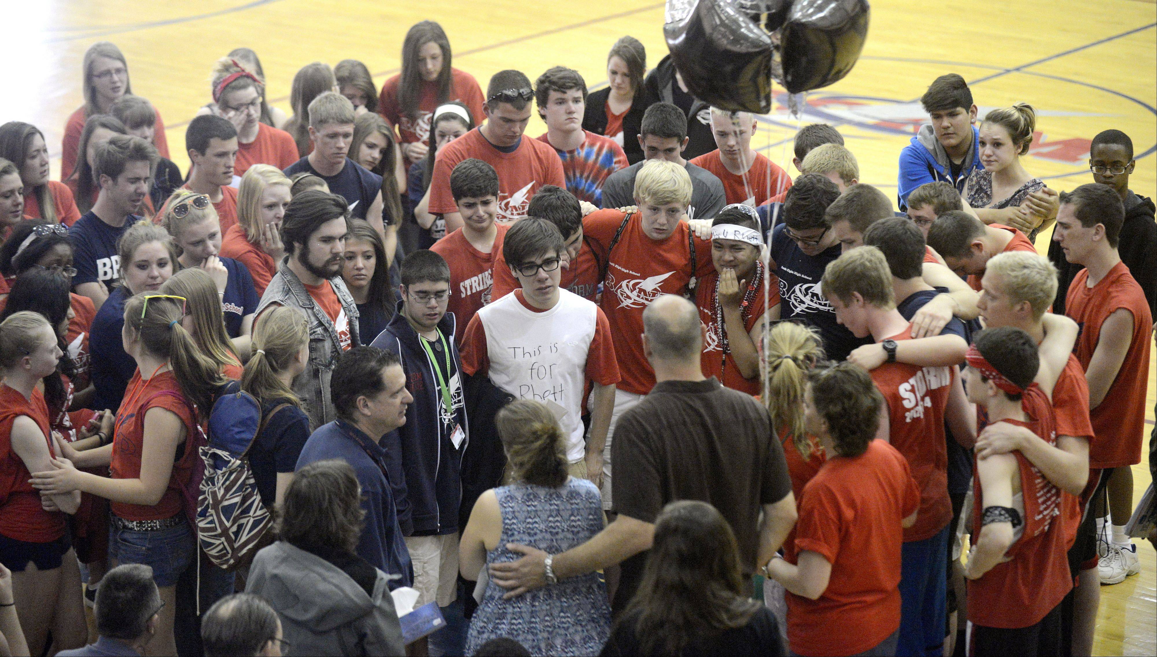 Students from the South Elgin High School drum line and other classmates gather in support for the family of their friend Rhett Lundy, who died in his sleep Wednesday.