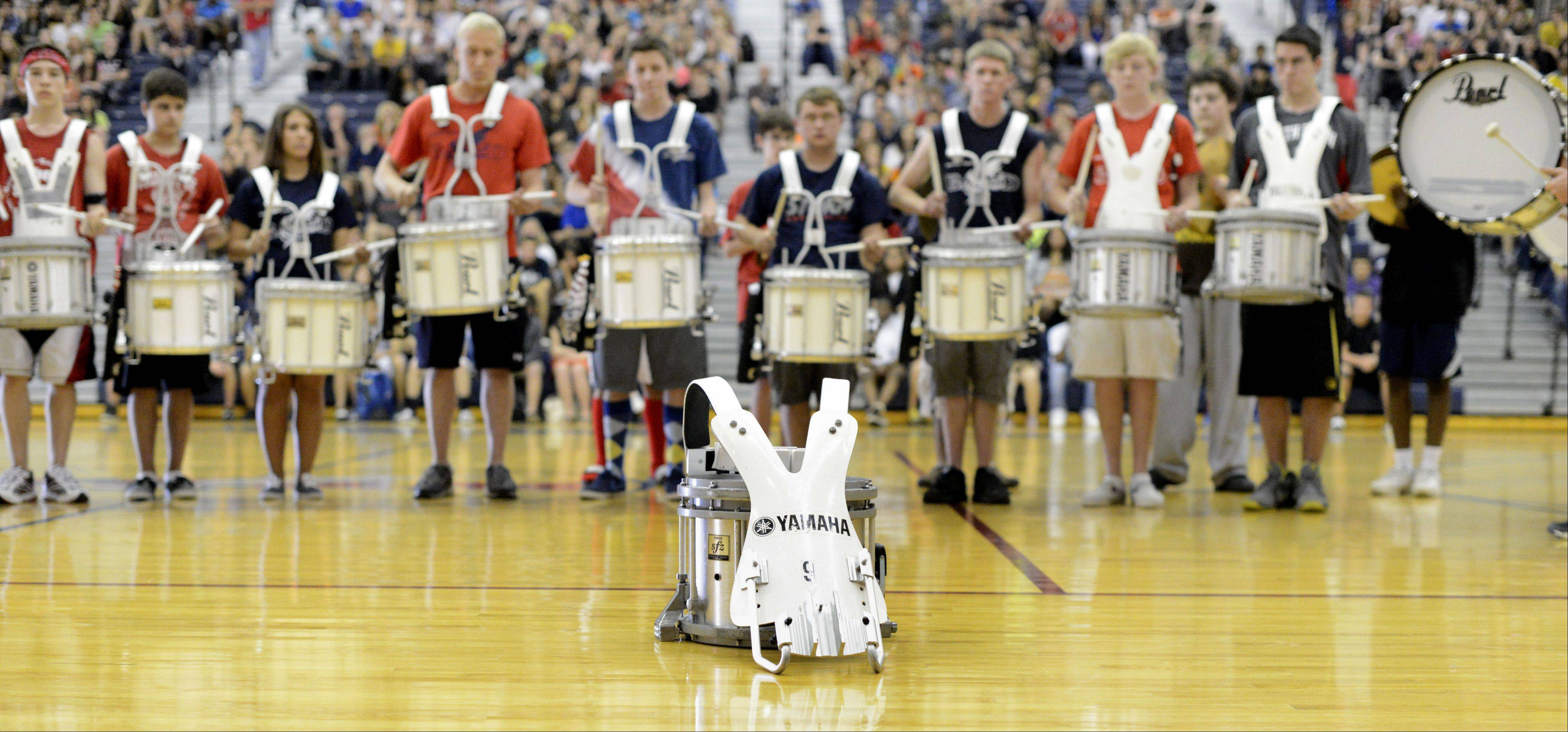 Freshman Rhett Lundy's drum sits in front of the South Elgin High School drum line as they perform a tribute to him in front of his family during a Friday assembly.