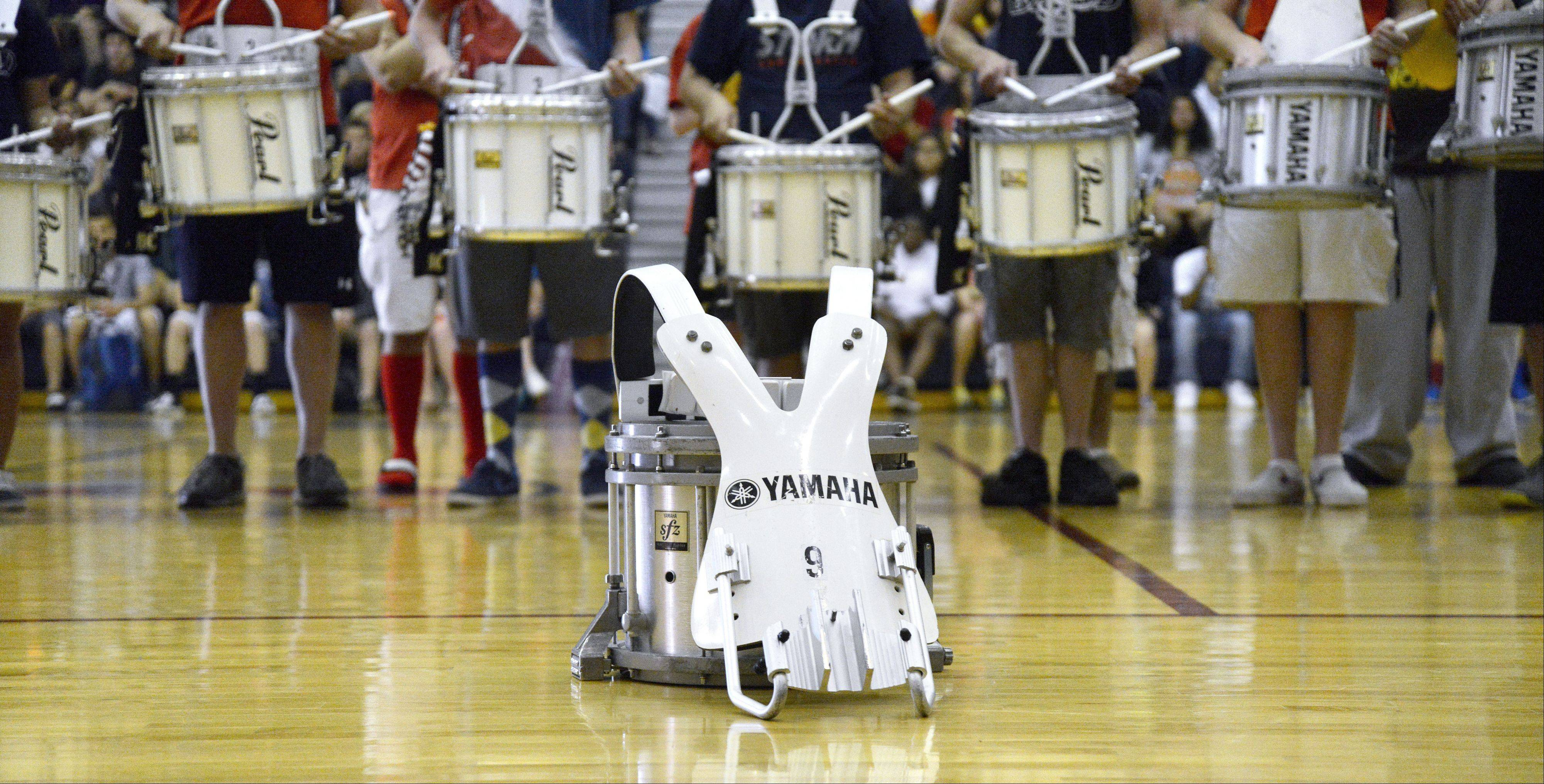 Freshman Rhett Lundy's drum sits in front of the South Elgin High School drum line Friday as they perform a tribute to him in front of his family during an assembly. Lundy died in his sleep Wednesday.