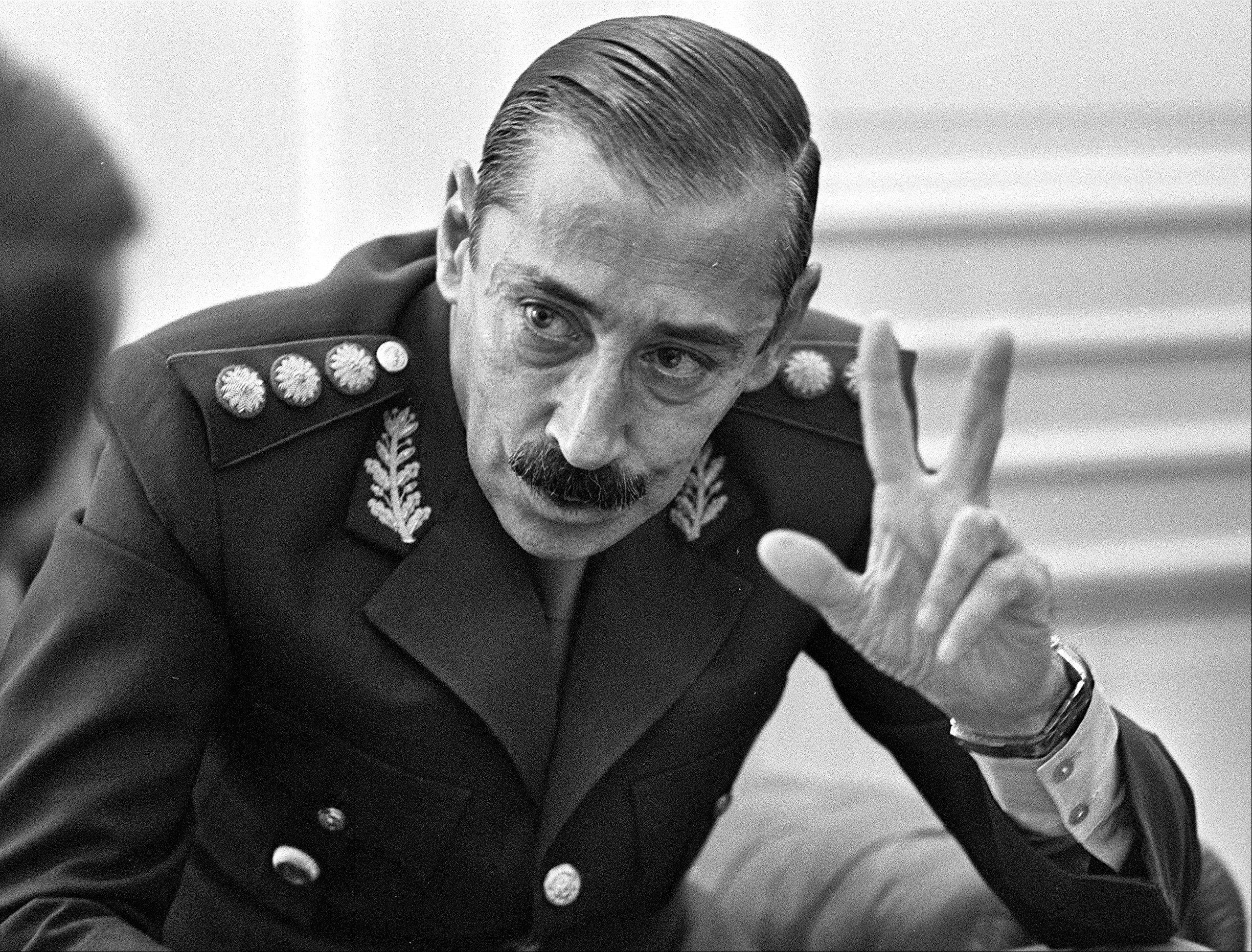 Gen. Jorge Rafael Videla talks to journalists at the Buenos Aires Government Palace, in Argentina.