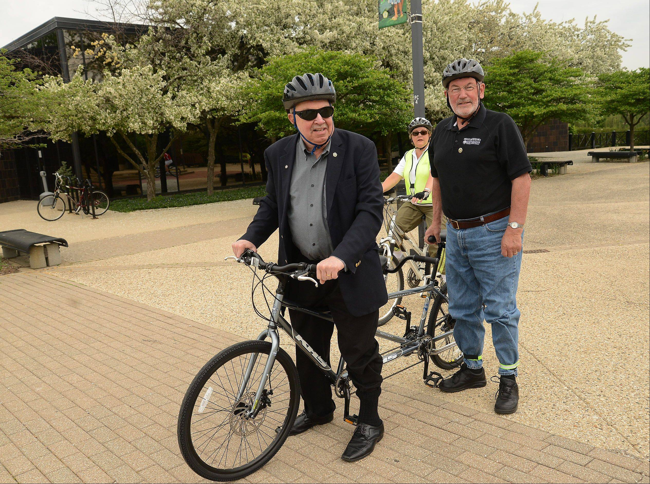 Schaumburg Mayor Al Larson and Schaumburg Park District Commissioner Bob Schmidt arrive safely at Larson's workplace of village hall after leading a bike ride from the Meineke Recreation Center to commemorate Bike to Work Week.