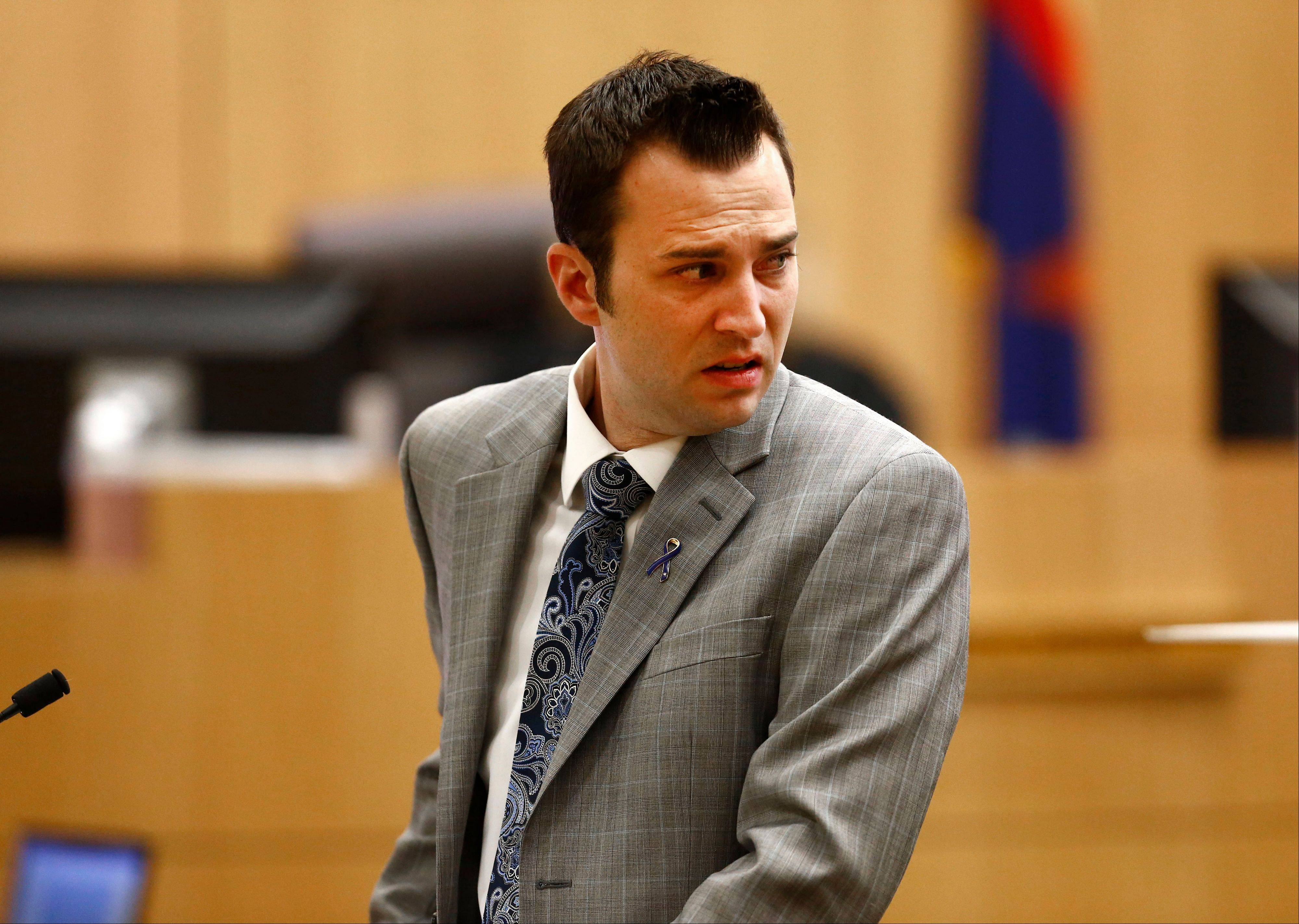 "Steven Alexander, brother of murder victim Travis Alexander, looks back toward Jodi Arias as he reads his ""victim impact statement"" to the jury on Thursday, May 16, 2013 during the penalty phase of the Jodi Arias trial at Maricopa County Superior Court in Phoenix. Jodi Arias was convicted of first-degree murder in the stabbing and shooting to death of Travis Alexander, 30, in his suburban Phoenix home in June 2008."