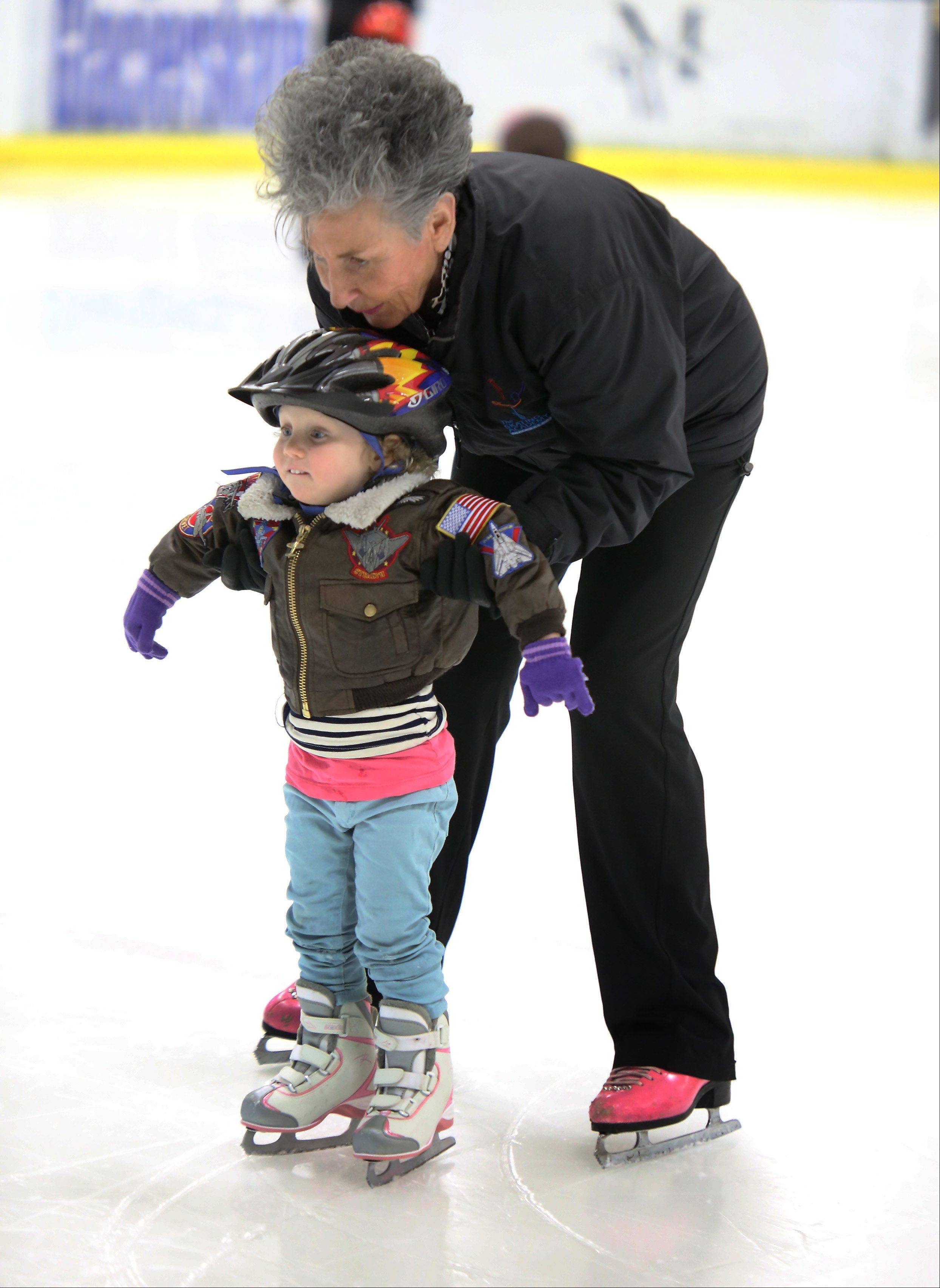 Ice skating teacher Karen Kay Lavris helps Lucy Wiener, 2, of Lincolnshire, learn to skate in a toddlers class at Glacier Ice Arena in Vernon Hills.