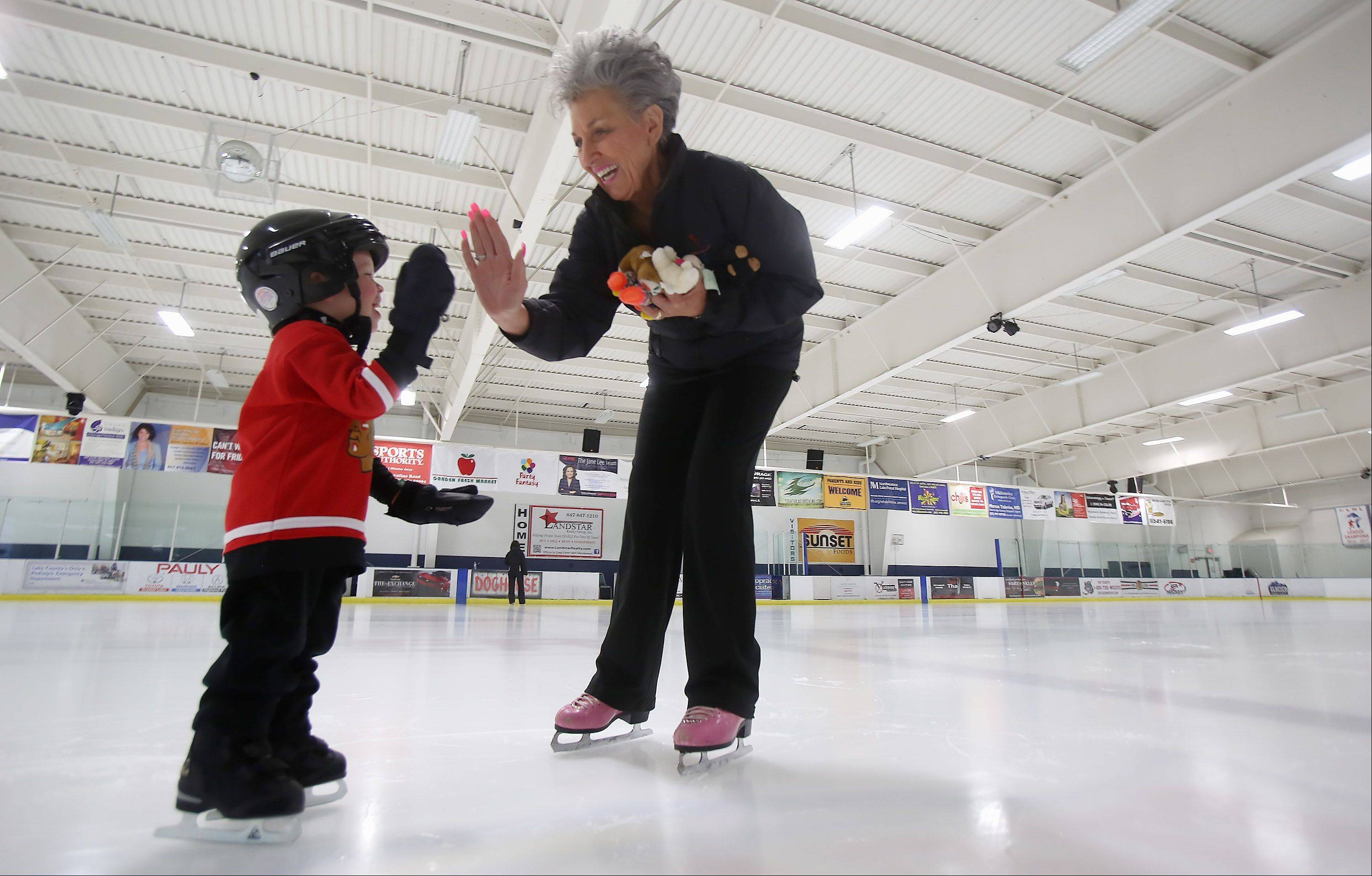 Ice skating instructor Karen Kay Lavris works with 2-year-old Ryan Shaffer, of Mettawa, at Glacier Ice Arena in Vernon Hills teaching him how to skate.