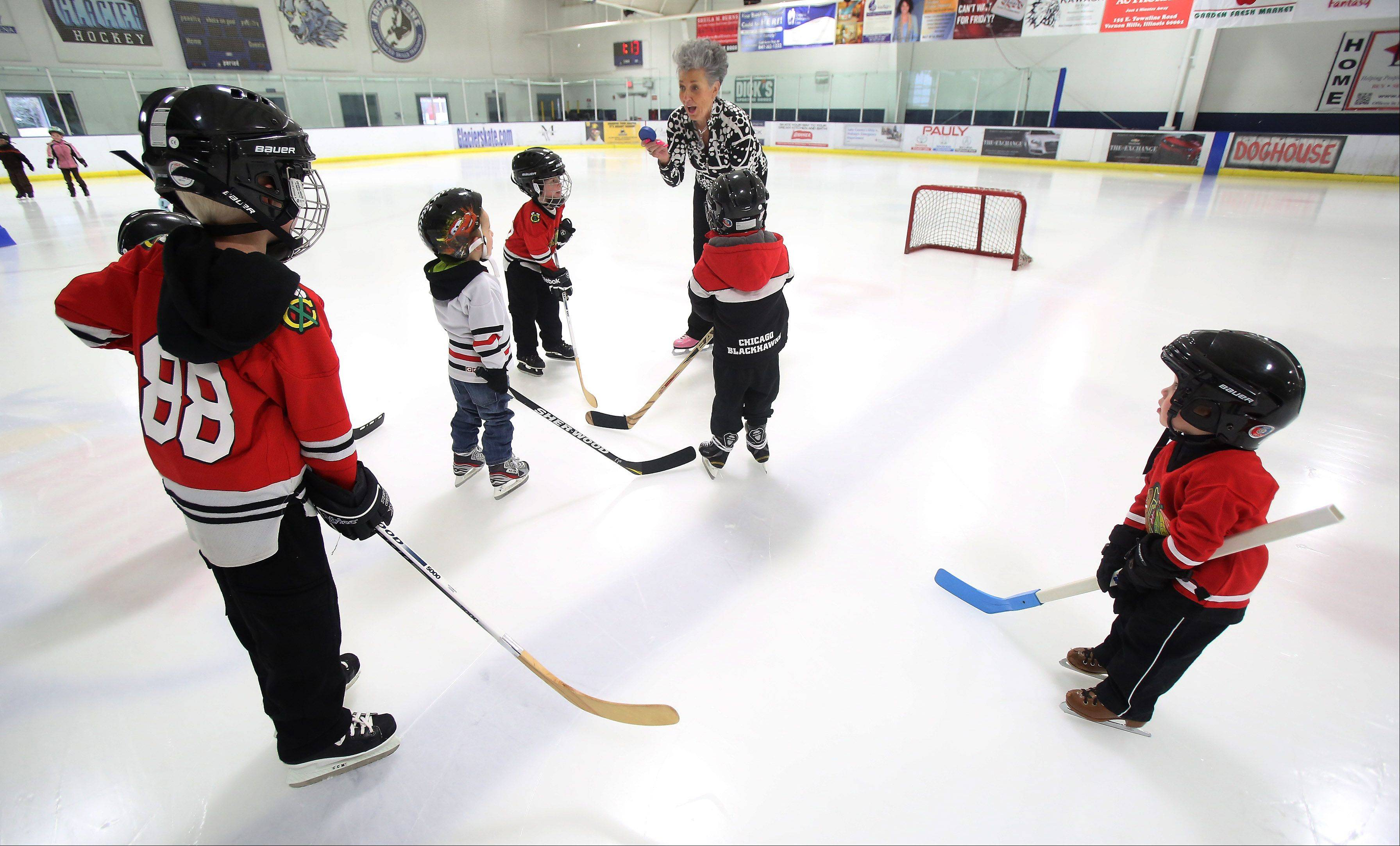 Karen Kay Lavris teaches youngsters to play hockey at Glacier Ice Arena in Vernon Hills.