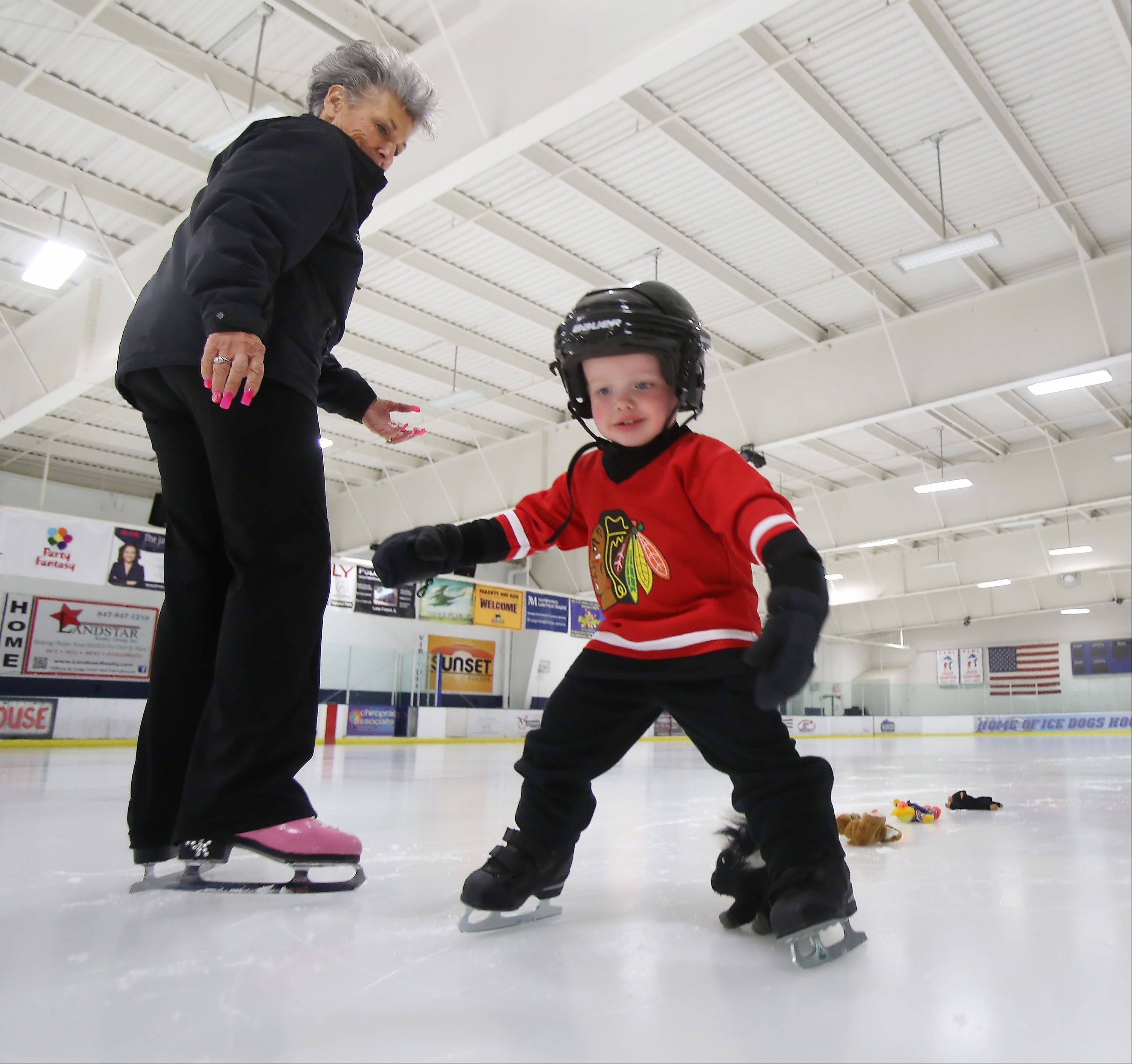 Ice skating teacher Karen Kay Lavris works with 2-year-old Ryan Shaffer, of Mettawa, at Glacier Ice Arena. Lavris has been at the arena since it opened 14 years ago.