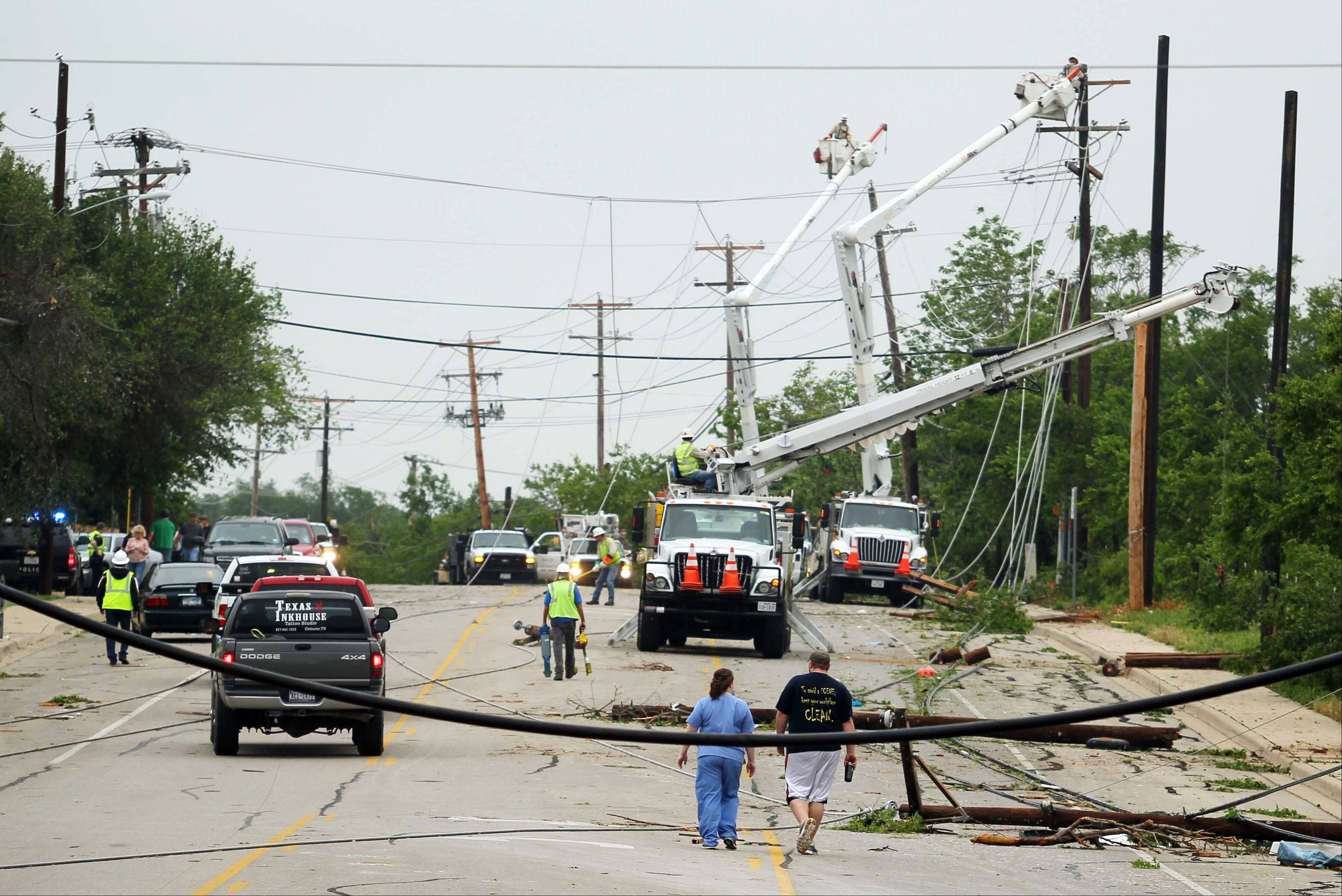 Crews work to clear power lines damaged by Wednesday's tornado in Cleburne, Texas on Thursday, May 16, 2013. Ten tornadoes touched down in several small communities in Texas overnight, leaving at least six people dead, dozens injured and hundreds homeless. Emergency responders were still searching for missing people Thursday afternoon.