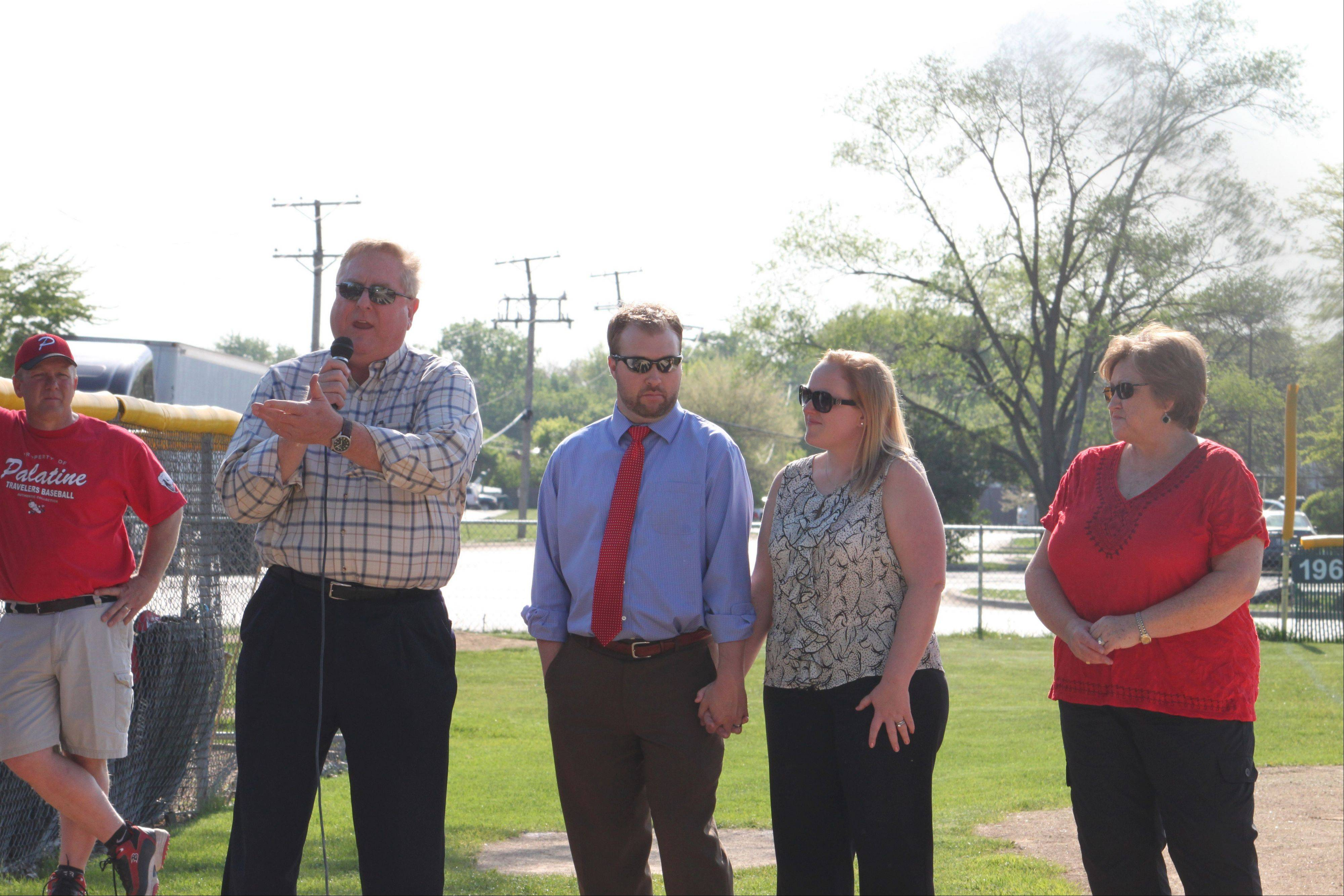 Steve Pohl, father of Casey Pohl, addresses the crowd as his son-in-law, Travis Siebrass, his daughter, Kimberly, and his wife, Debbie, listen during a ceremony to retire Casey's No. 47 on Thursday in Palatine.