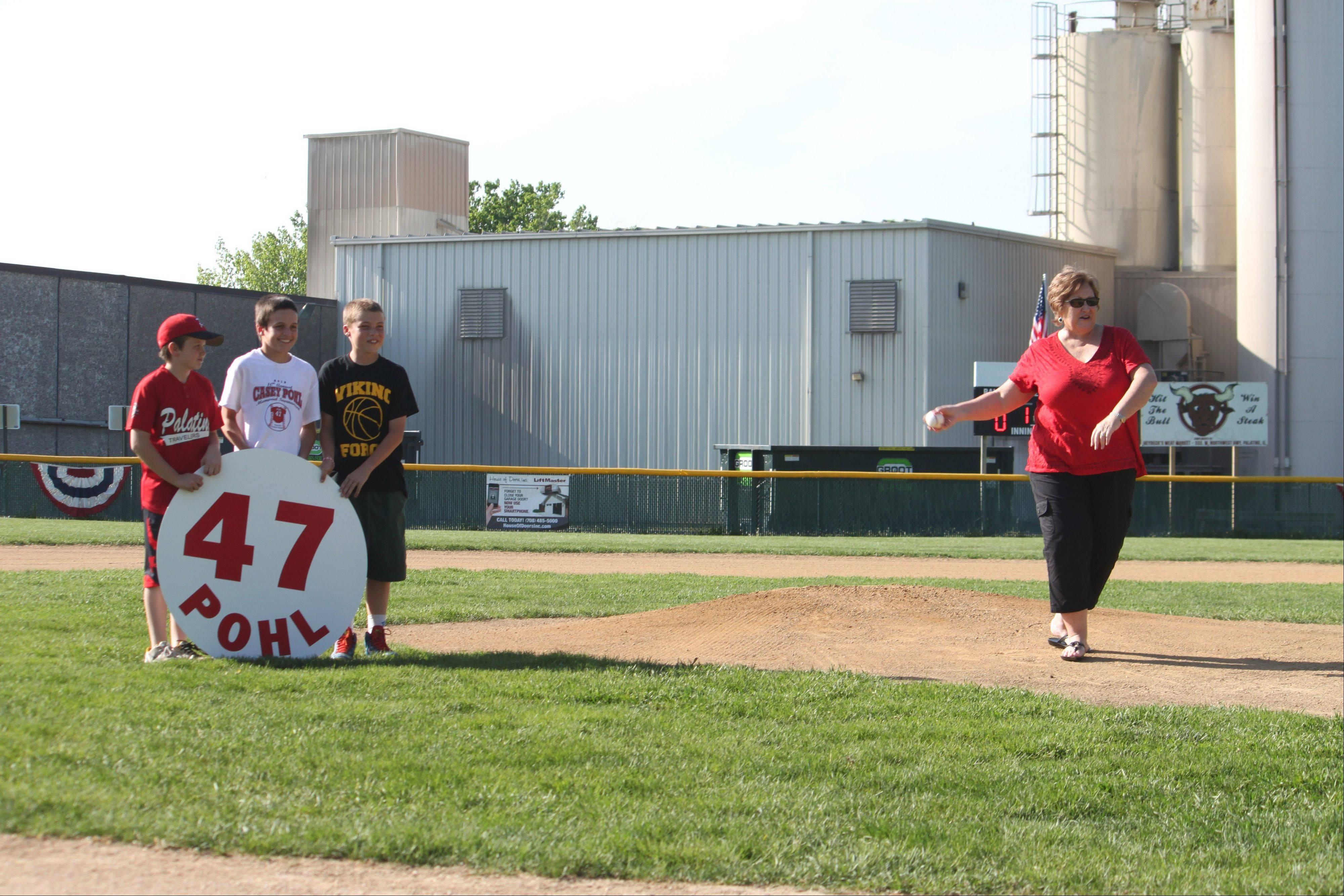 Debbie Pohl throws out the first pitch on Thursday at the Casey Pohl Memorial Tournament in Palatine.