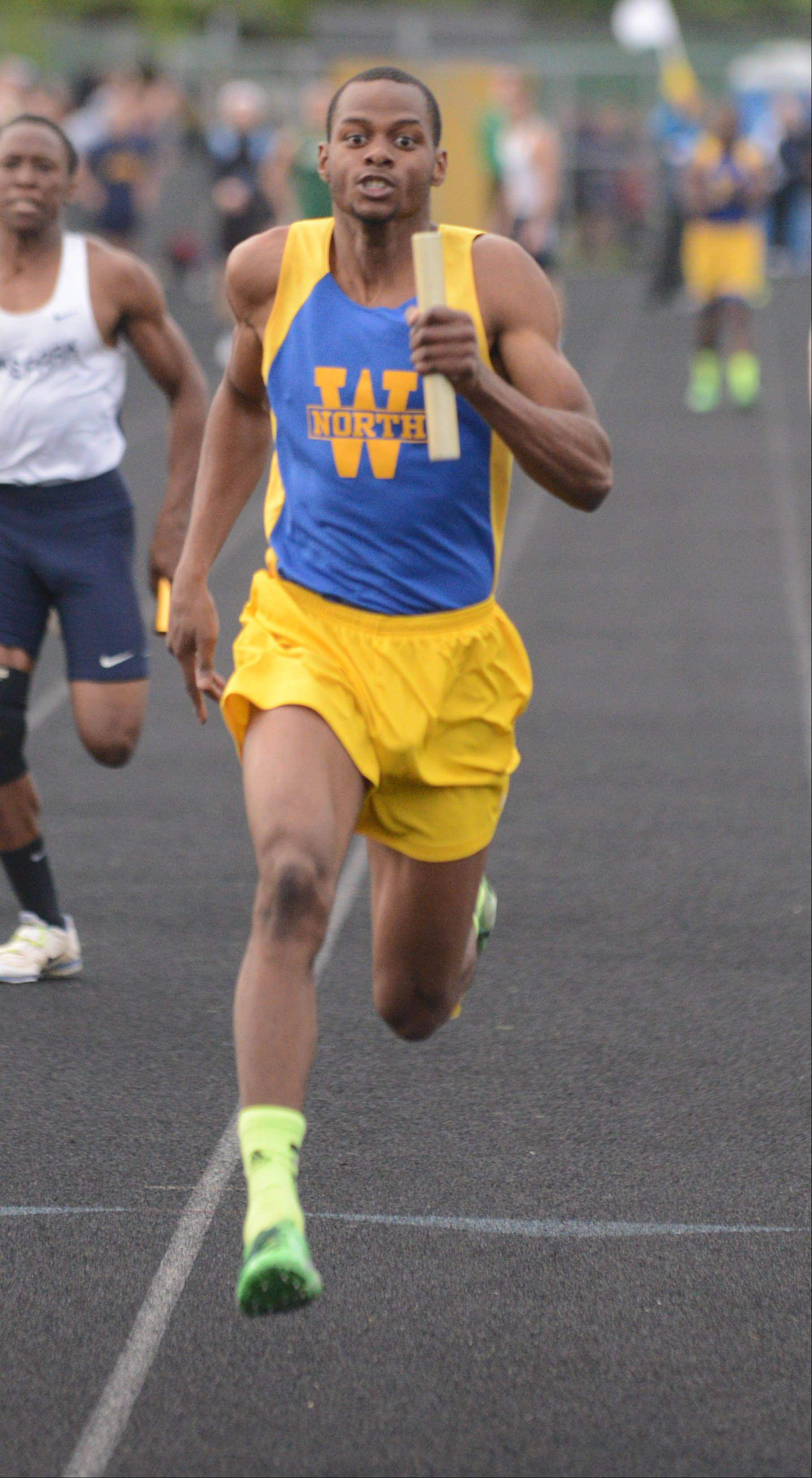 Zach Gordon of Wheaton North runs in the 4x100 Meter relay during the Class 3A Glenbard North boys track sectional finals Friday.
