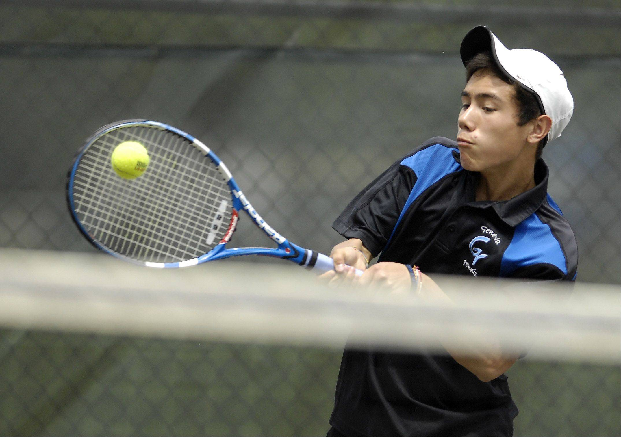 Geneva's Nick Haung returns serve during his first round doubles match during sectional tennis action at Geneva High School Friday.