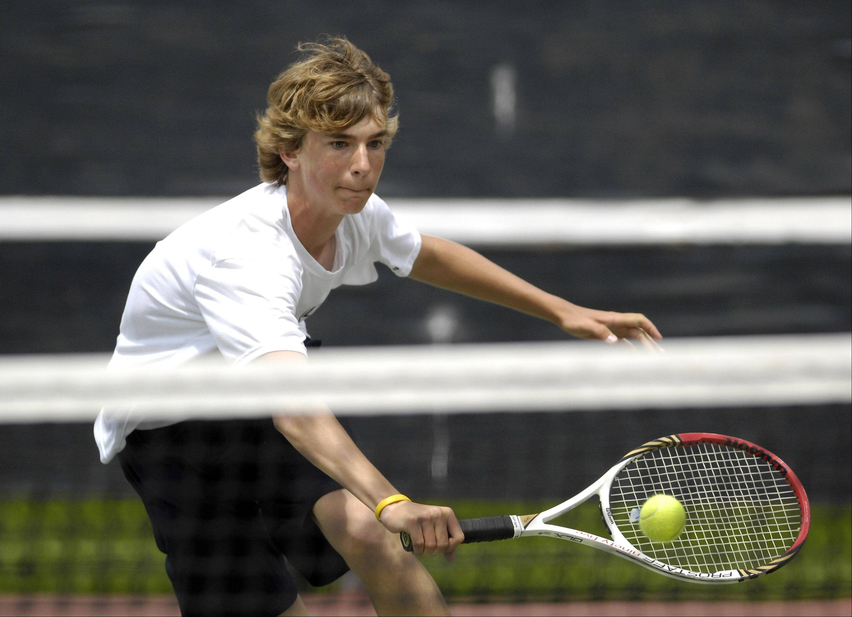 Lake Park's Jack Millikan lunges for a backhand at the net during a doubles match at sectional tennis action at Geneva High School Friday.