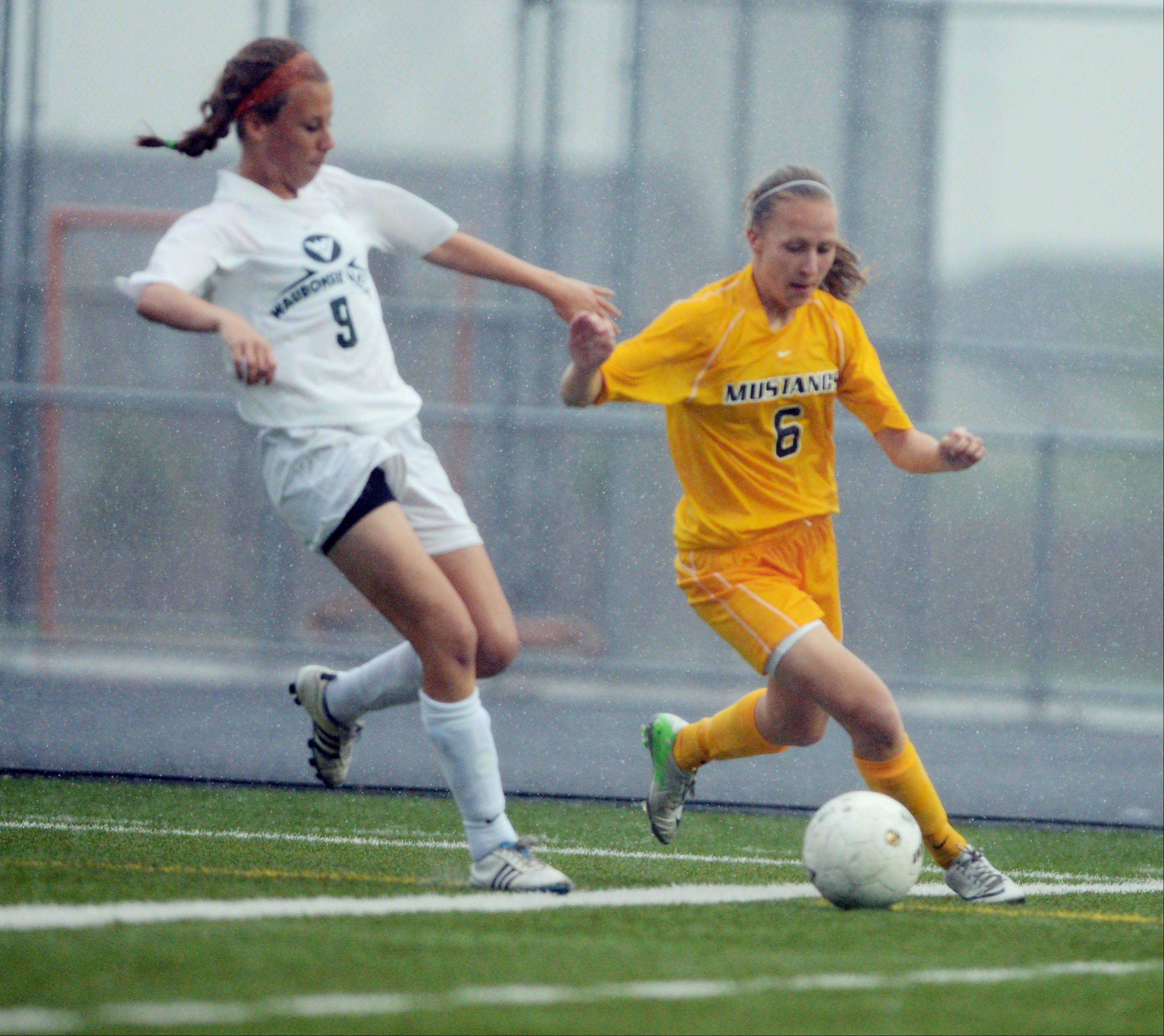 Rachael Brots of Waubonsie,left, and Alena Sidwell of Metea chase the ball durimng the class 3A Metea Valley girls soccer regional final Friday.