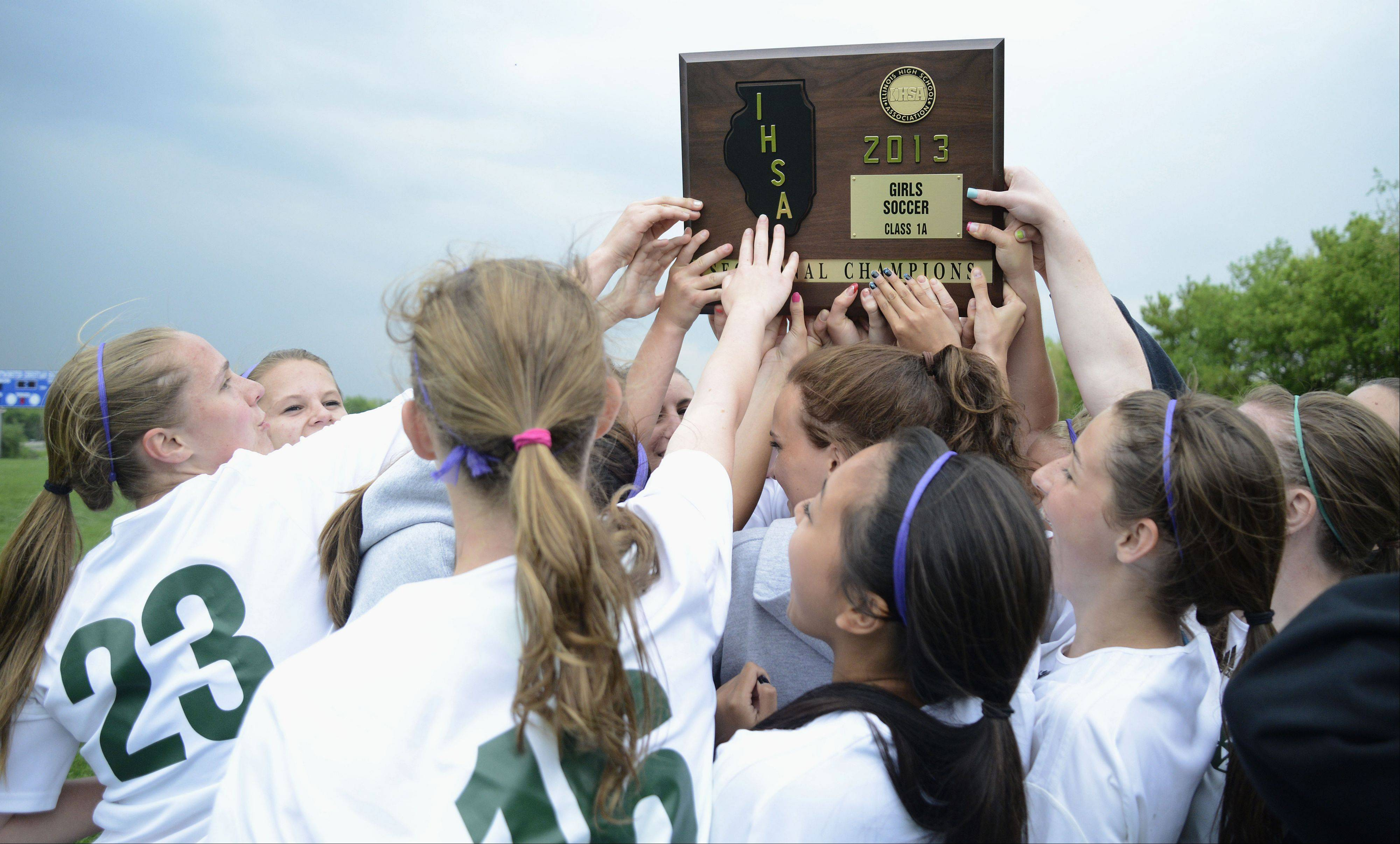 The St. Edward girls soccer team celebrates its Class 1A Westminster Christian sectional title over Willows Academy on Friday.