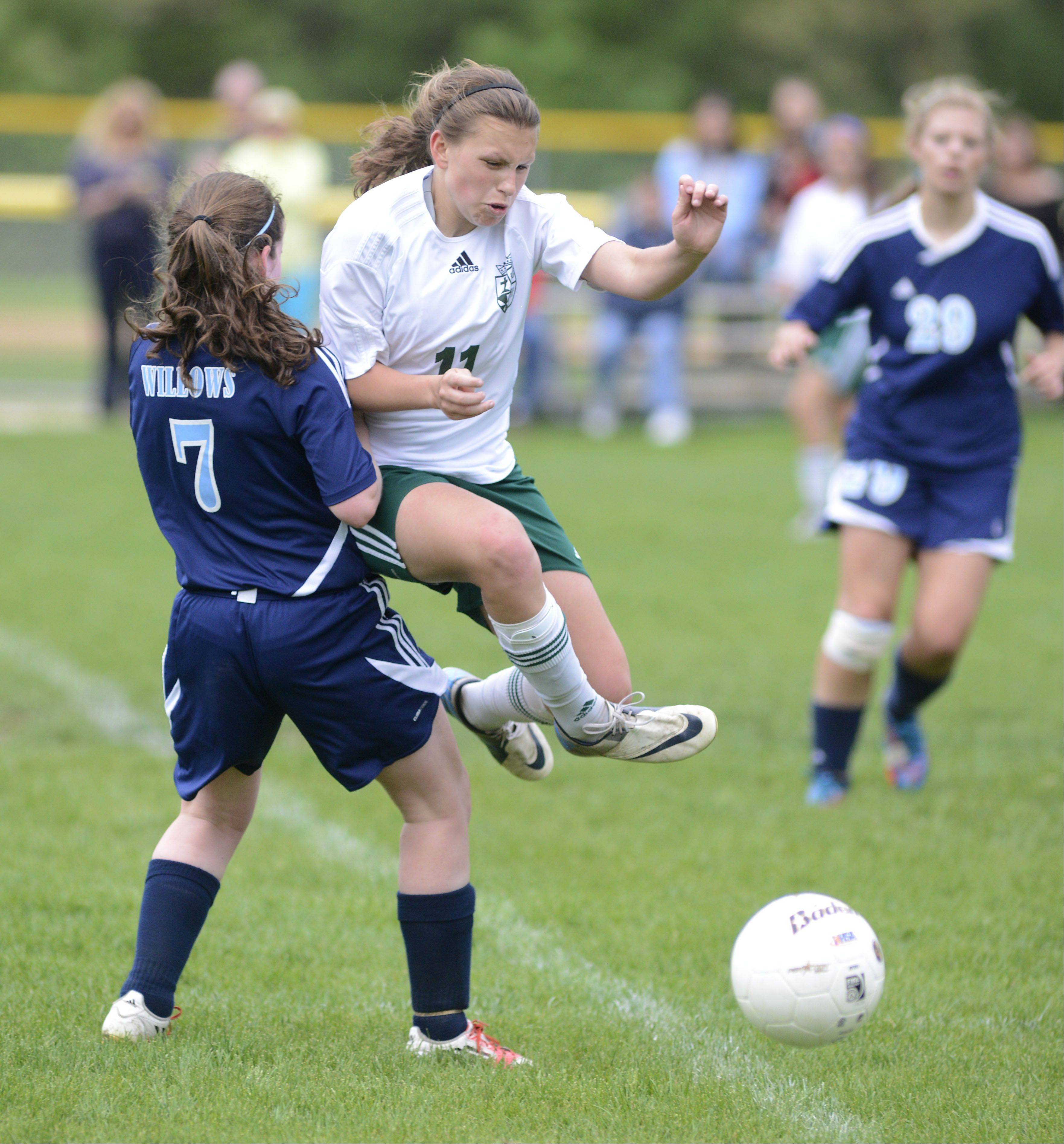 St. Edward's Allison Kruk leaps to avoid tripping over the leg of Willows Academy's Maura Walsh in the second half of the Class 1A girls soccer sectional title game on Friday, May 17.