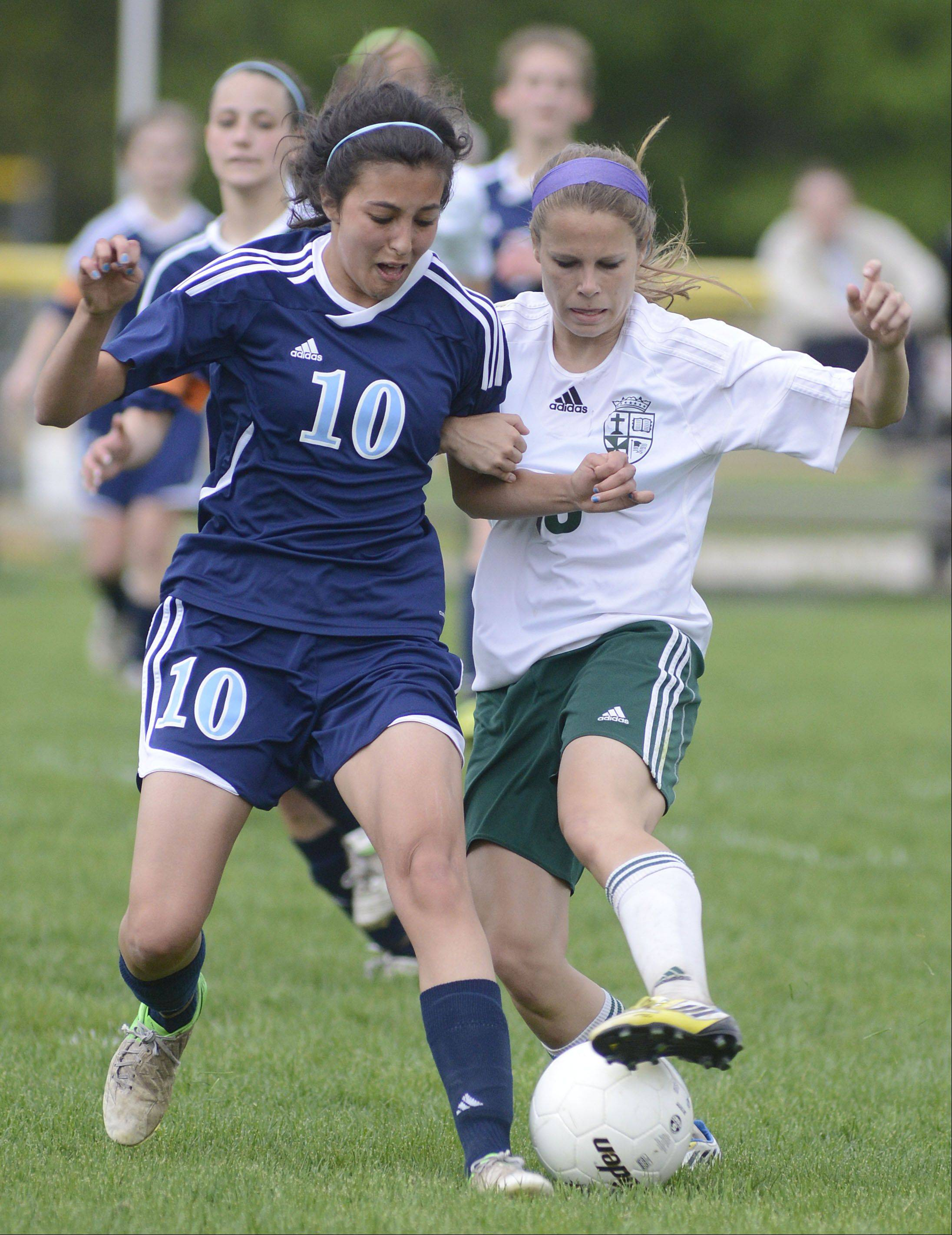 Willows Academy's Marta Brown and St. Edward's Meagan Kearney battle for the ball in the second half of the Class 1A girls soccer sectional title game on Friday, May 17.