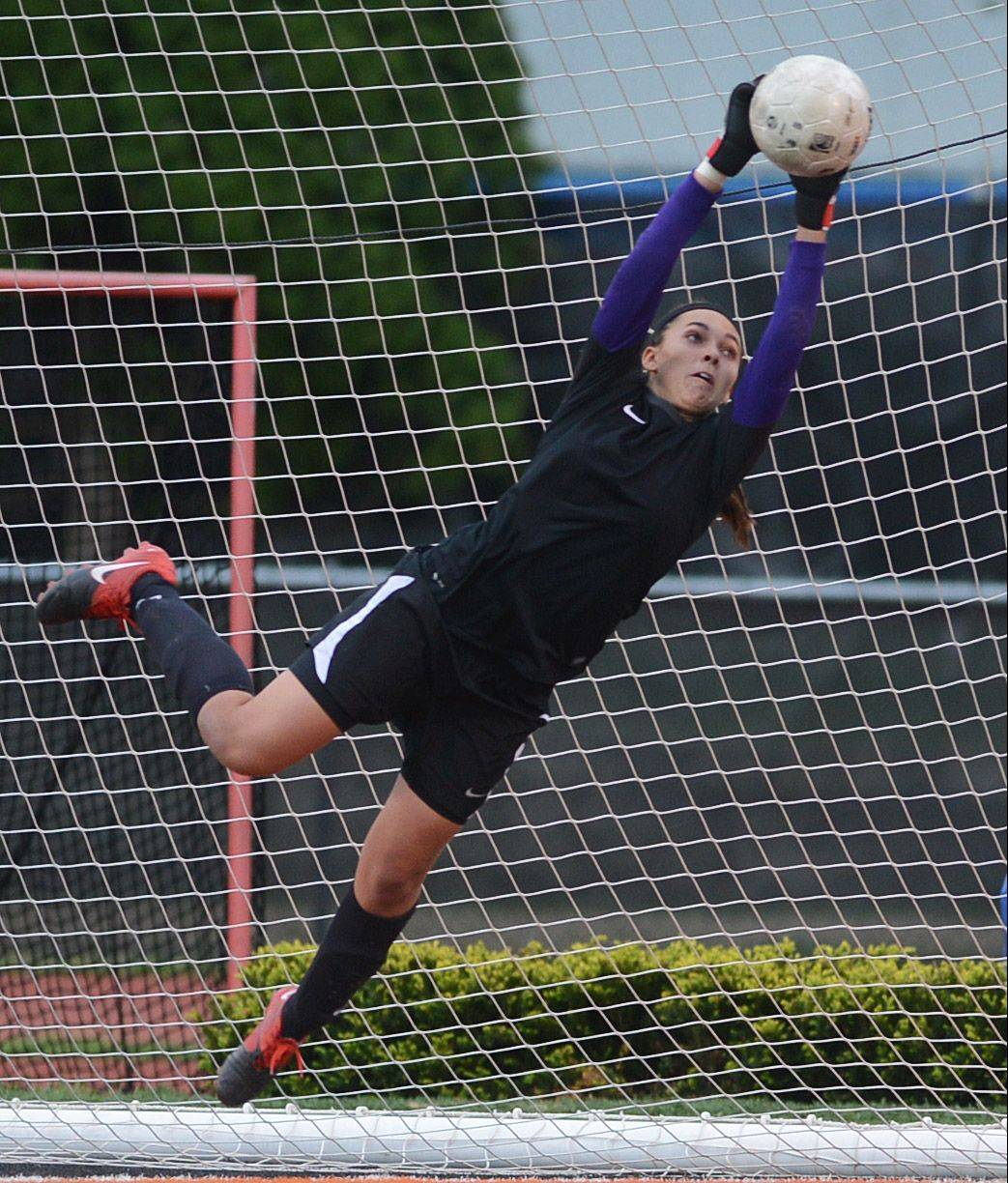 Mundelein goalkeeper Brooke Dennis makes a leaping save against Buffalo Grove during Friday's Class 3A girls soccer regional final at Libertyville.