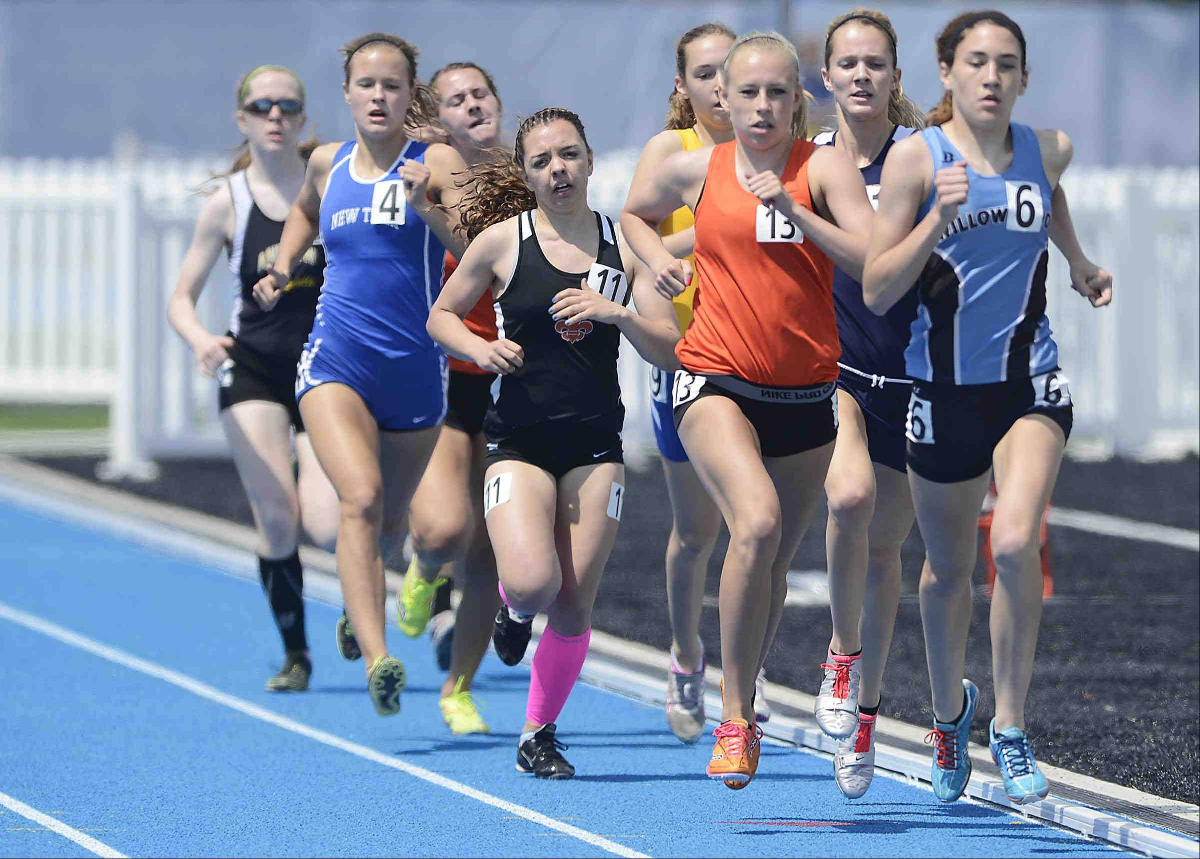 Willowbrook's Molly Krawczykowski, right, Wheaton Warrenville South's McKenna Kiple, middle, and St. Charles East's Corrin Adams, left, control the lane in their heat of the 800 meter run Friday at the Class 3A girls state track and field preliminaries at O'Brien Stadium at Eastern Illinois University in Charleston.