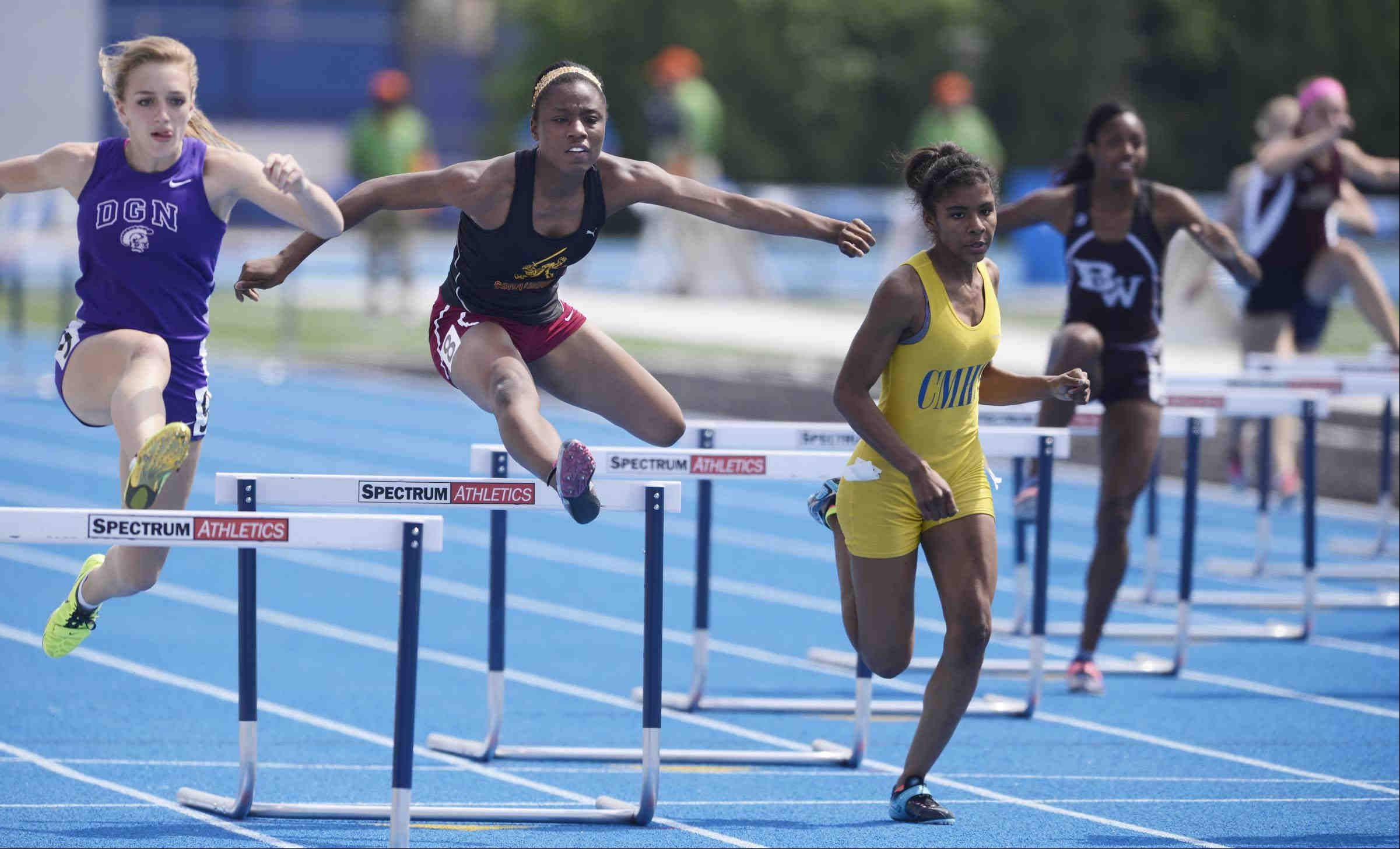 Schaumburg's Darneisha Spann clears the second obstacle in the 300-meter low hurdles Friday at the Class 3A girls state track and field preliminaries.