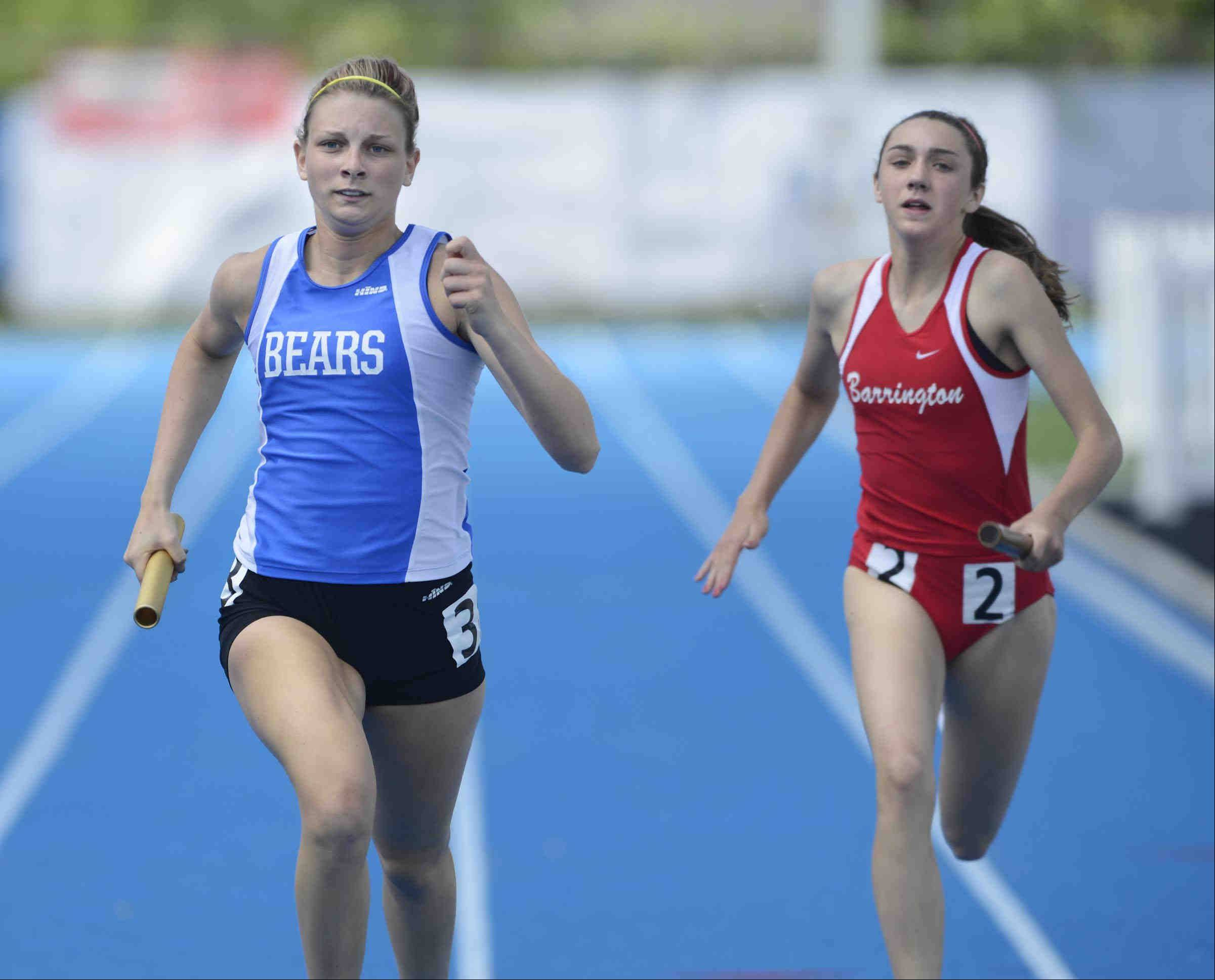 Lake Zurich's Lindsey Moritz leads Barrington's Sara-Kate Capel to the finish of the 800-meter relay Friday at the Class 3A girls state track and field preliminaries at O'Brien Stadium.