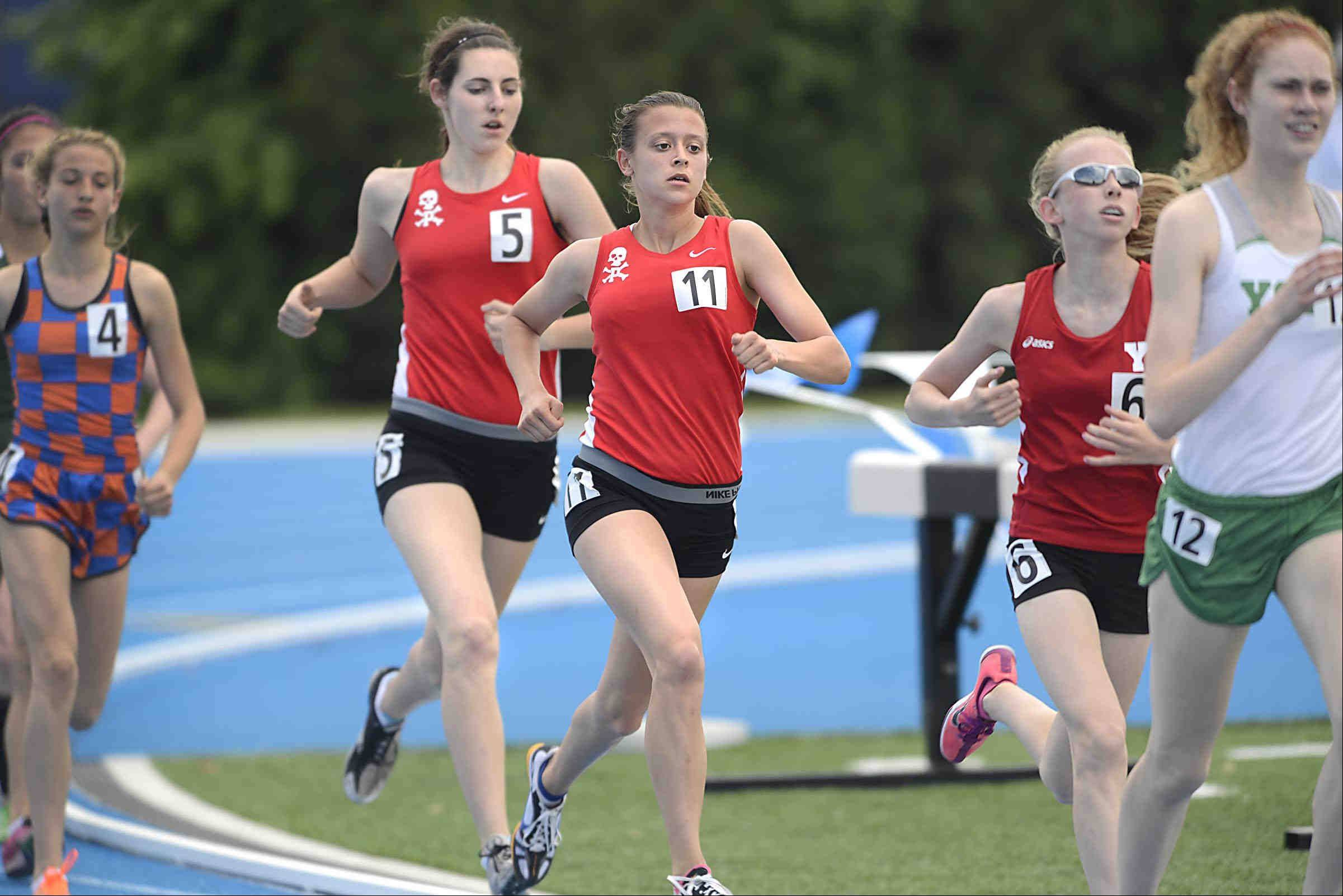 Palatine's Tess Wasowicz and teammate Liz Cox run together in their heat of the 1,600 meter run Friday in the Class 3A girls state track and field preliminaries at Eastern Illinois University.