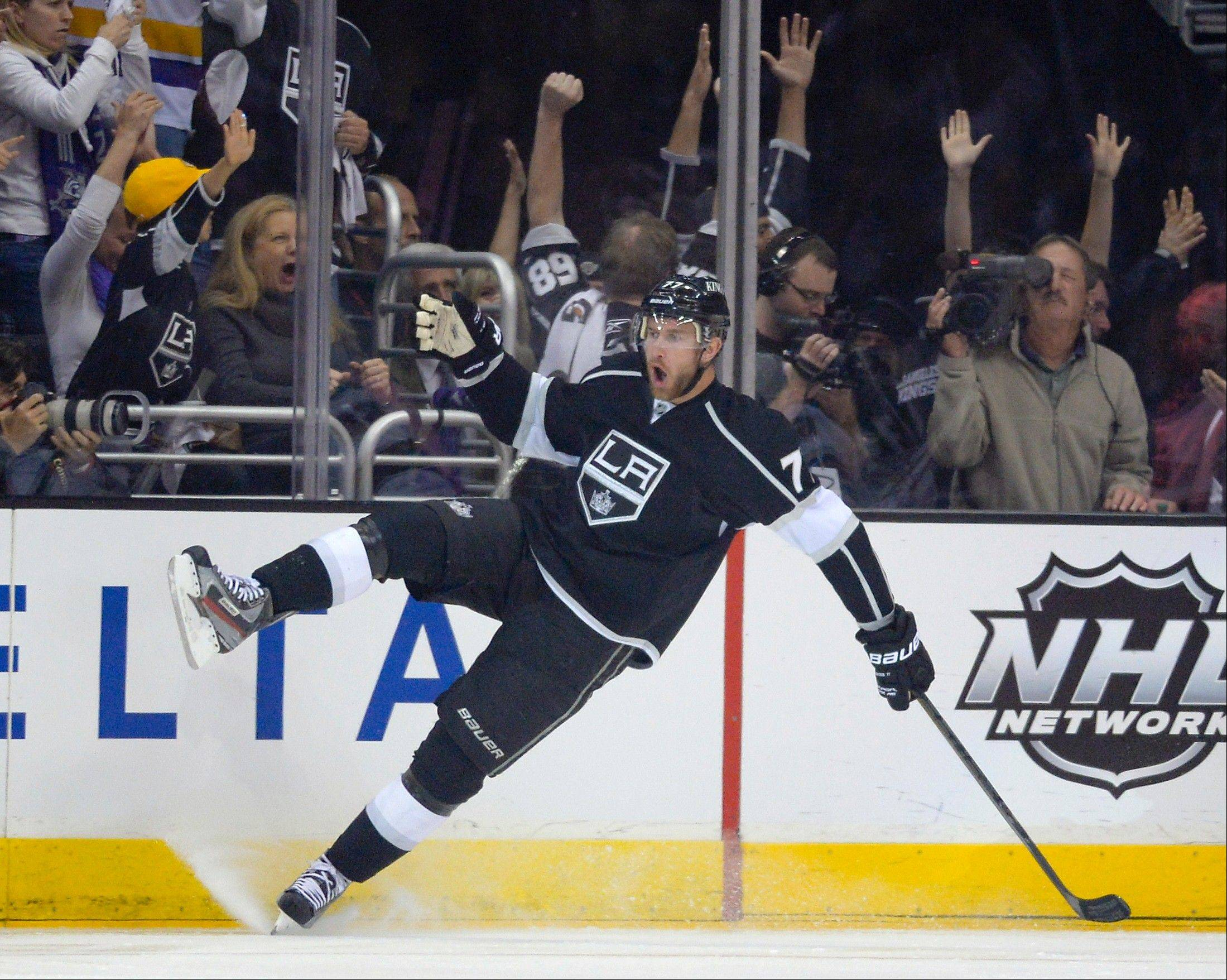 Los Angeles Kings center Jeff Carter celebrates his goal against the San Jose Sharks during the first period in Game 2 of a second-round NHL hockey Stanley Cup playoff series, Thursday, May 16, 2013, in Los Angeles.