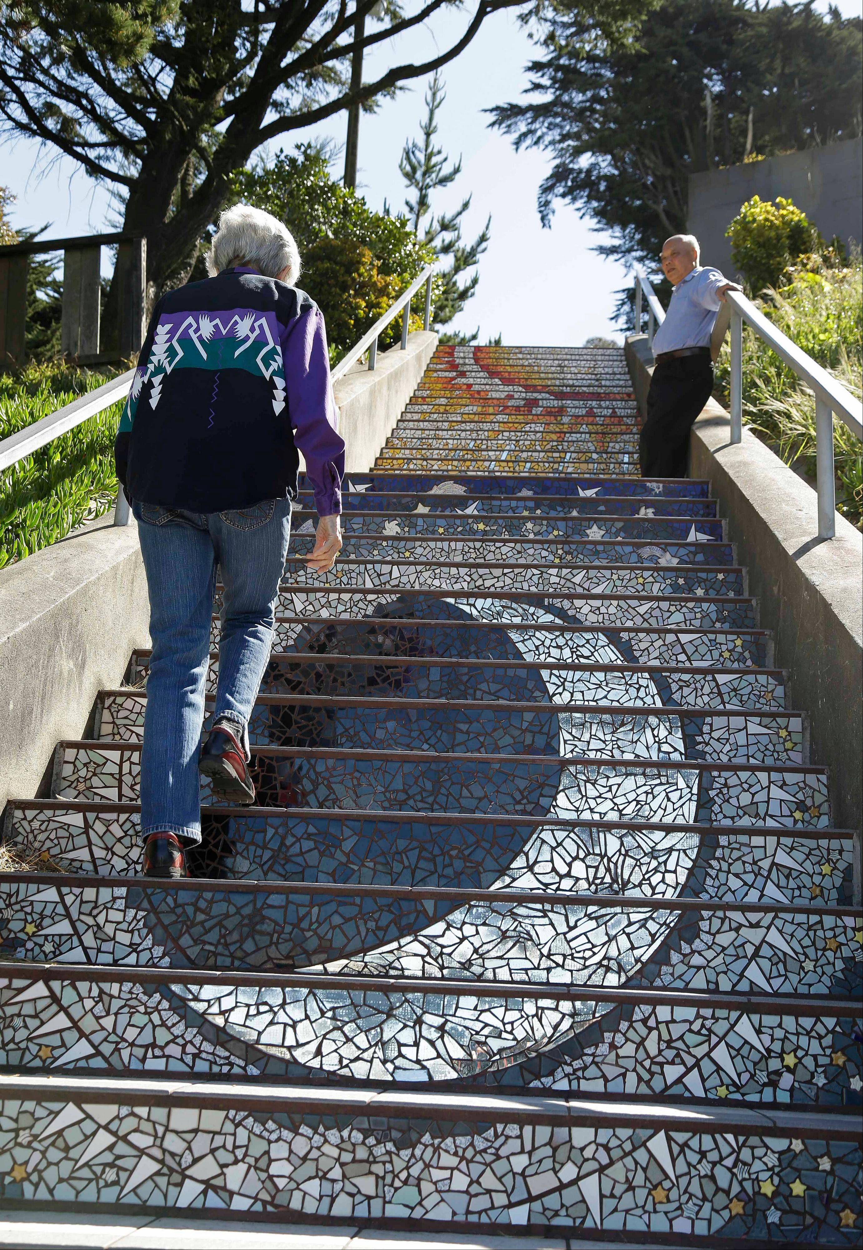 Ninety-year-old Adah Bakalinsky, left, climbs the 163-step mosaic stairway of Golden Gate Heights in San Francisco. In San Francisco, Bakalinsky says there are more than 650 public stairways in her city.