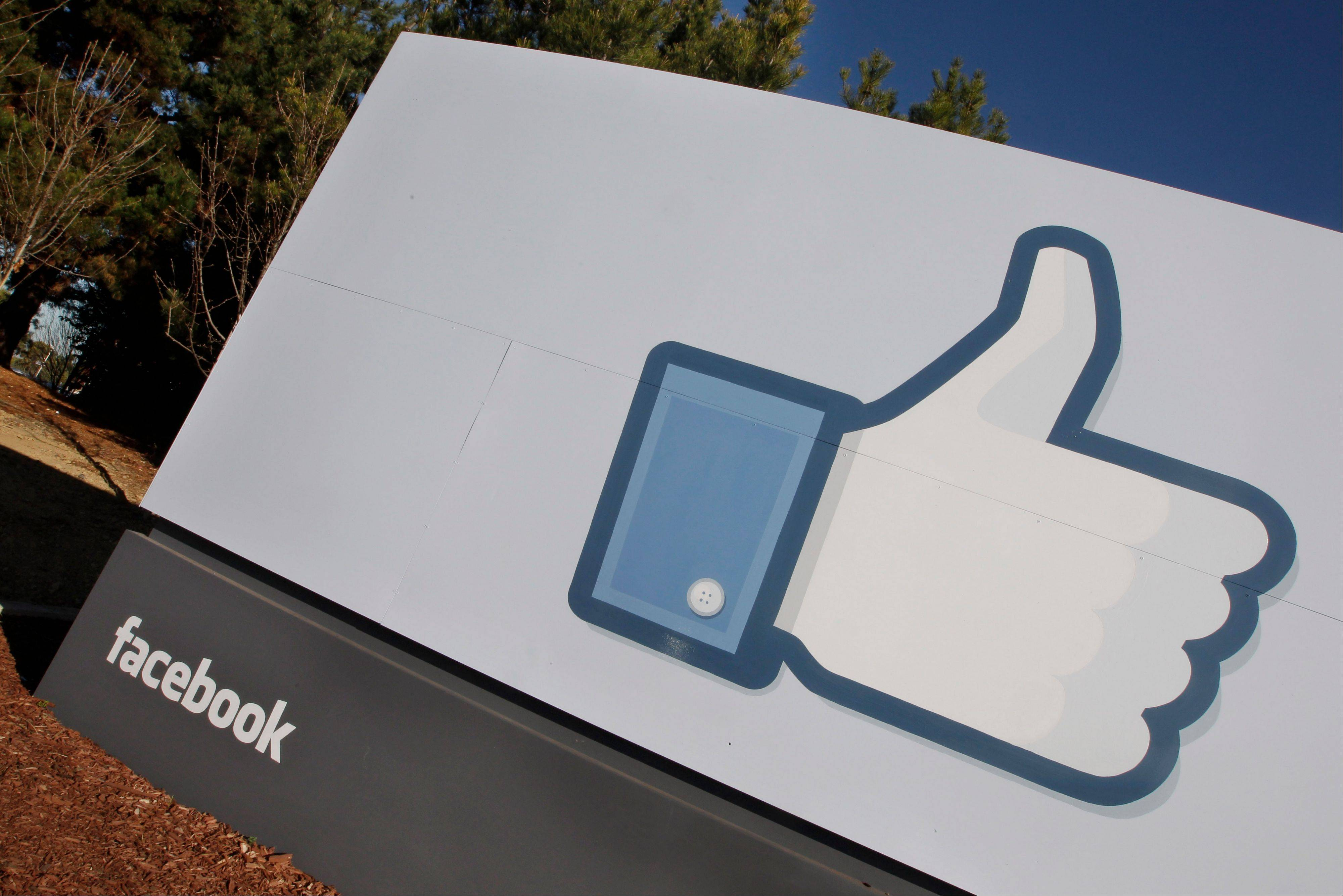 The Facebook logo is displayed outside of Facebook's new headquarters in Menlo Park, Calif.