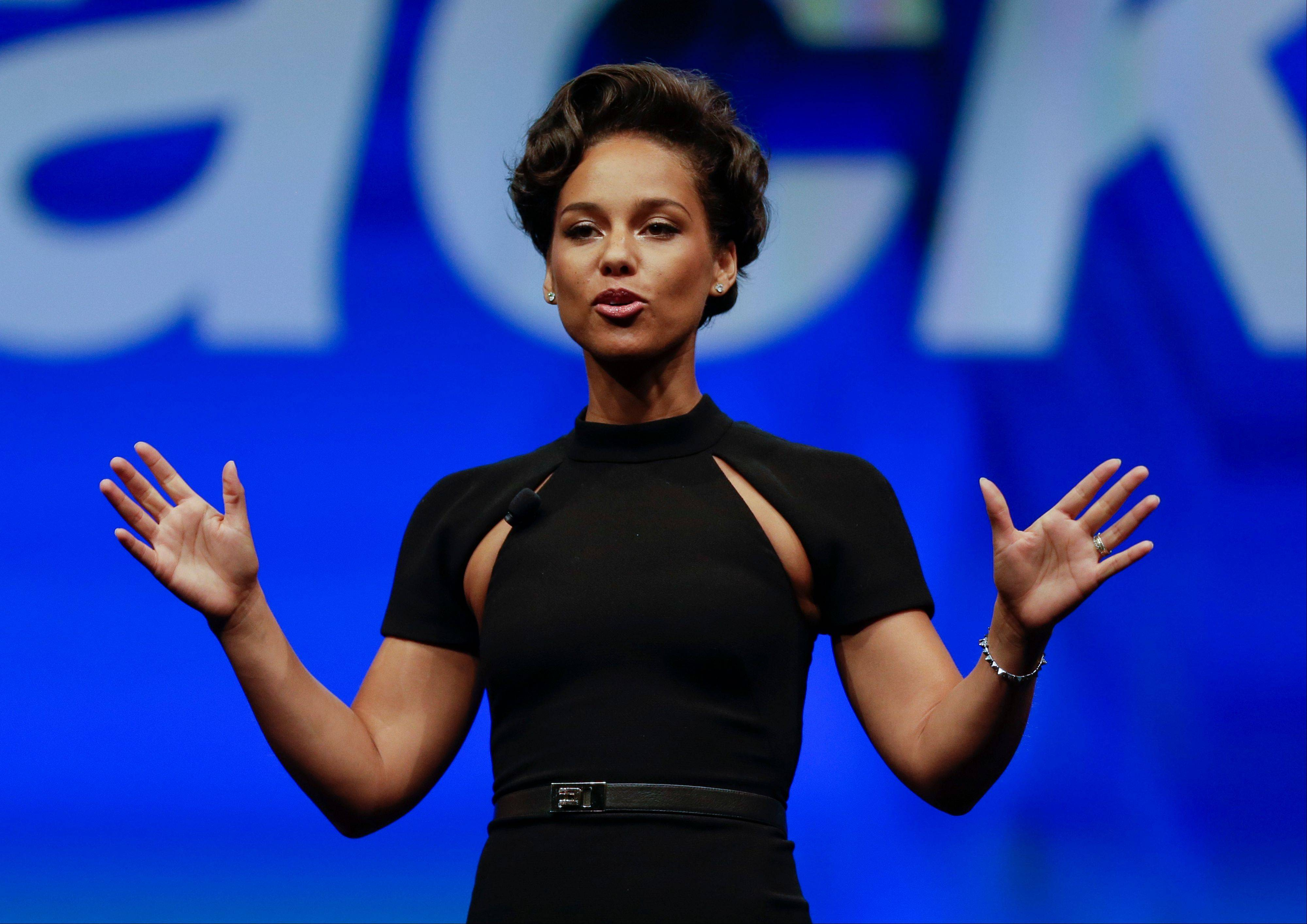 Entertainer Alicia Keys, Global Creative Director for BlackBerry, speaks Tuesday at a conference in Orlando, Fla.