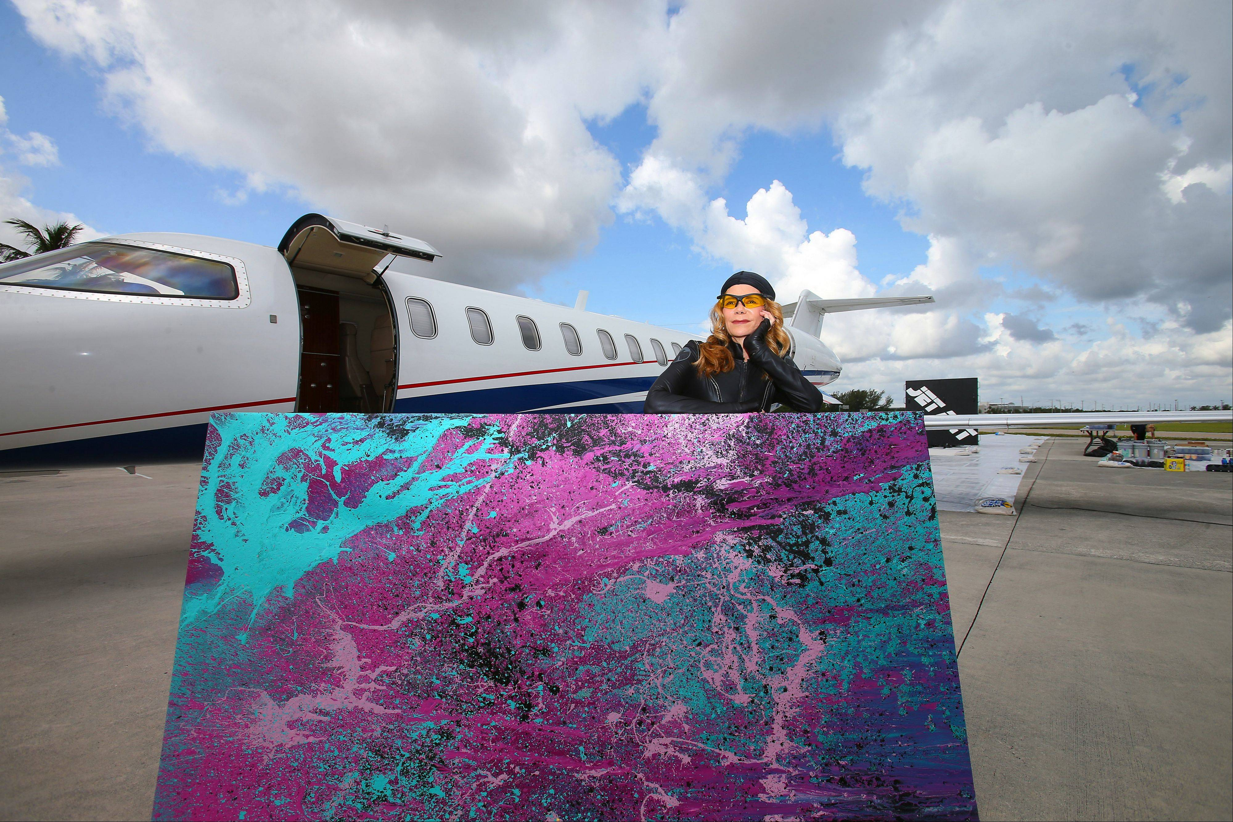 Artist Princess Tarinan von Anhalt shows off one of her splatter creations made with the help of a jet engine.