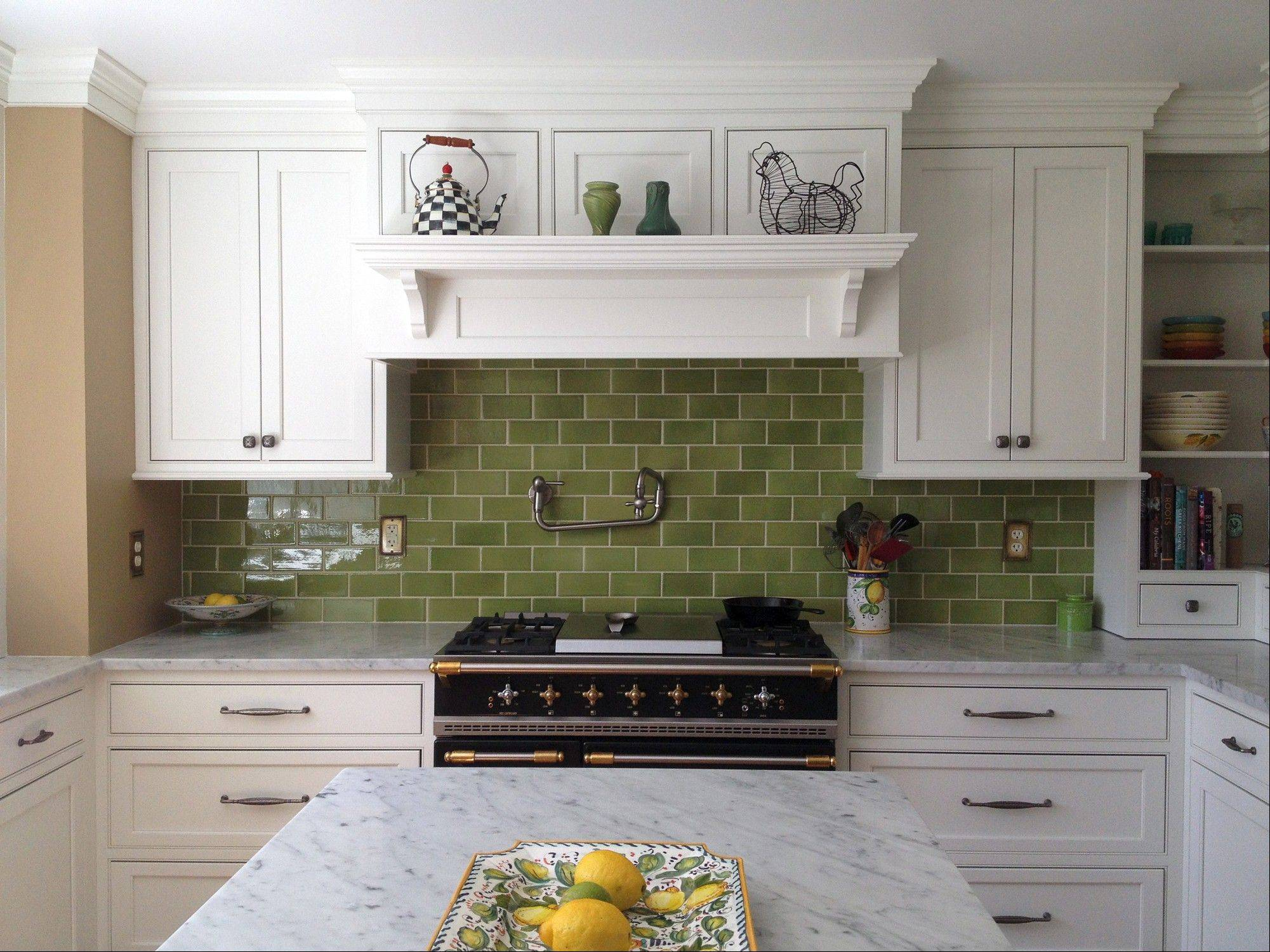 Domenica Marchetti's two-month kitchen renovation was a mix of must-haves and compromises. The heavy duty French range and marble countertops count among the former while the semi-custom cabinets and green subway tiles were among the latter.