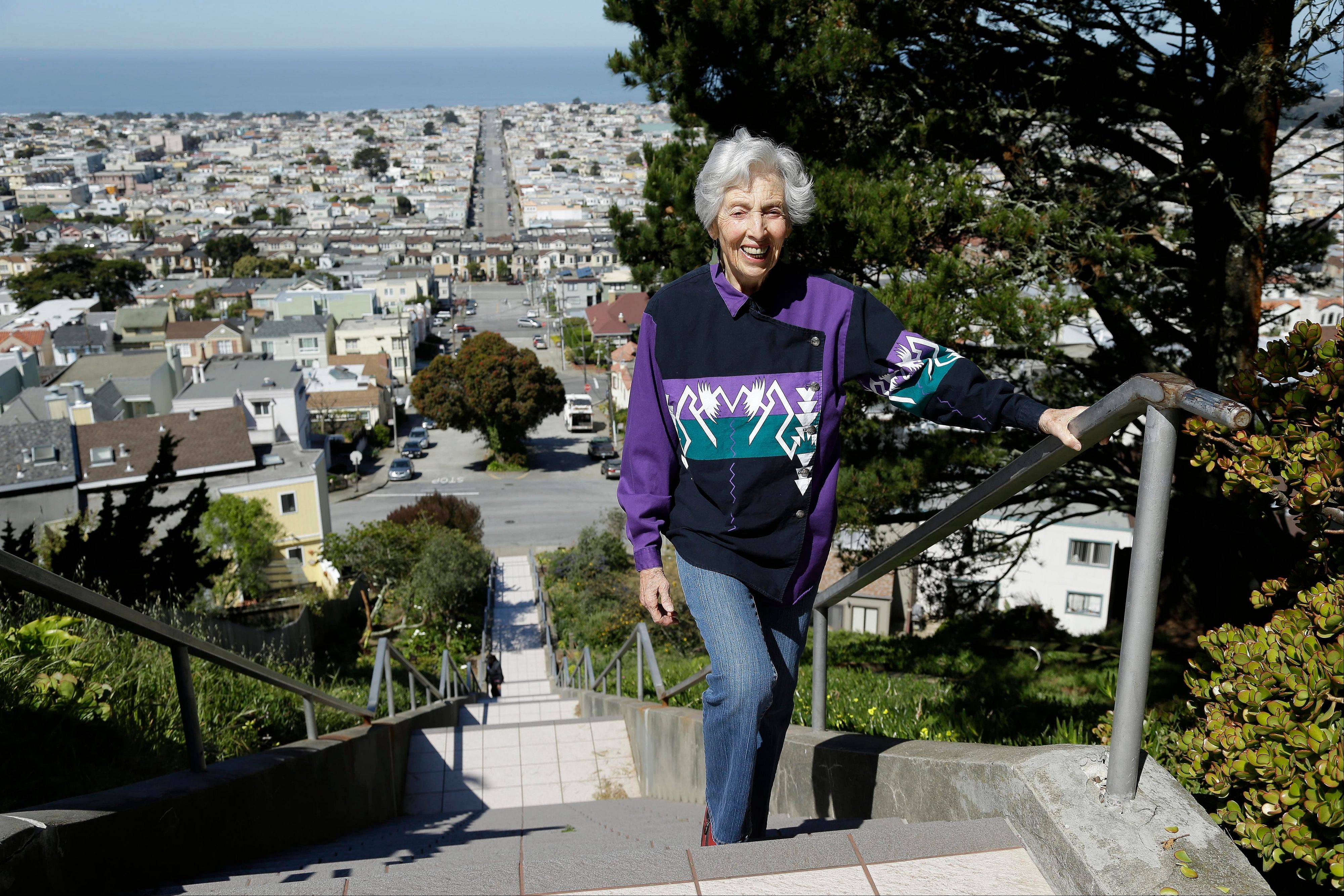 Adah Bakalinsky, left, reaches the top of the 163-step mosaic stairway of Golden Gate Heights in San Francisco. Bakalinsky, 90, has written two books about hiking on public stairways; books that are lessons in nature, architecture and history.