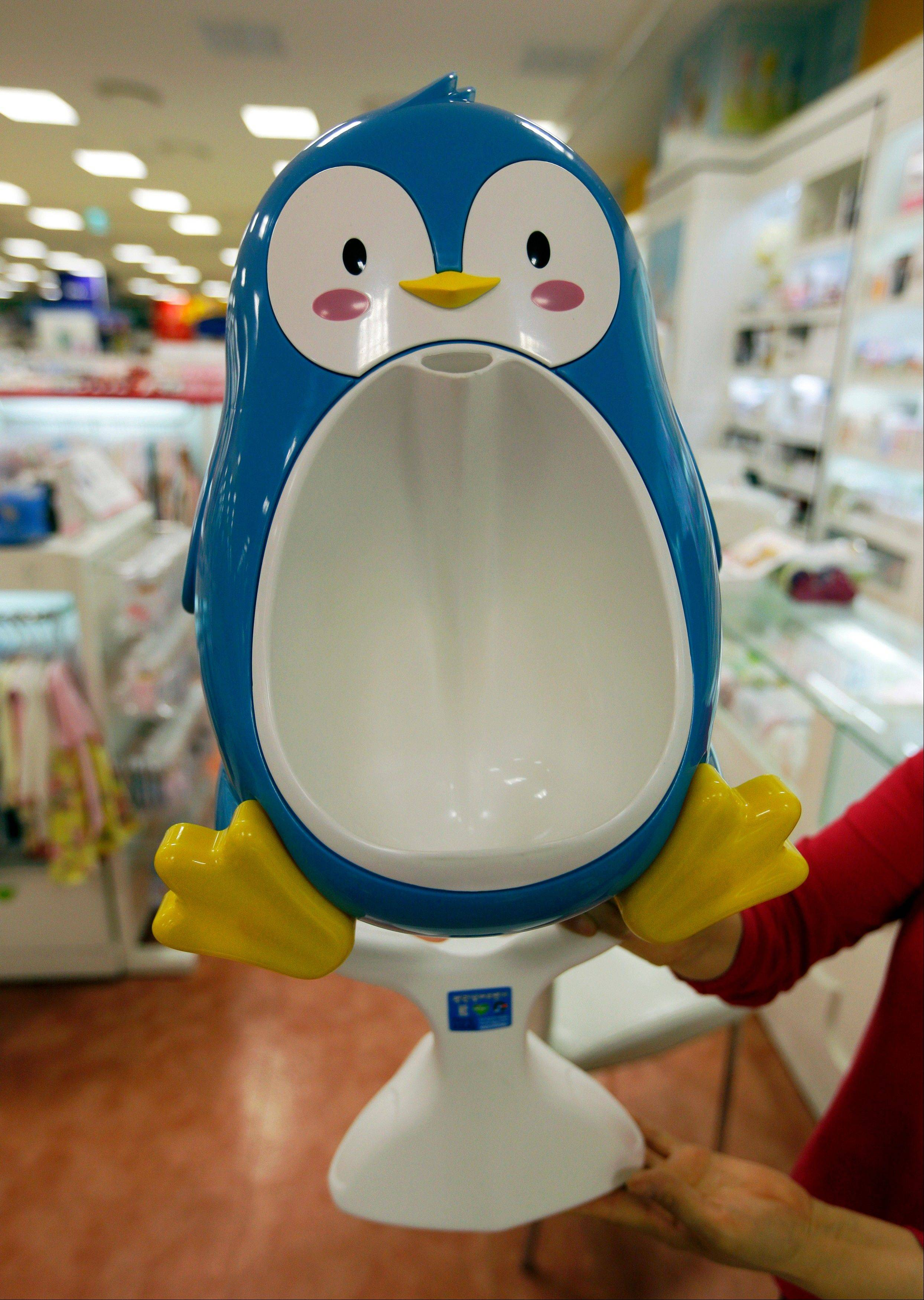 A penguin-shaped urinal for boy's training is available in a shop in Seoul, South Korea. For some parents, summertime is potty-training time.