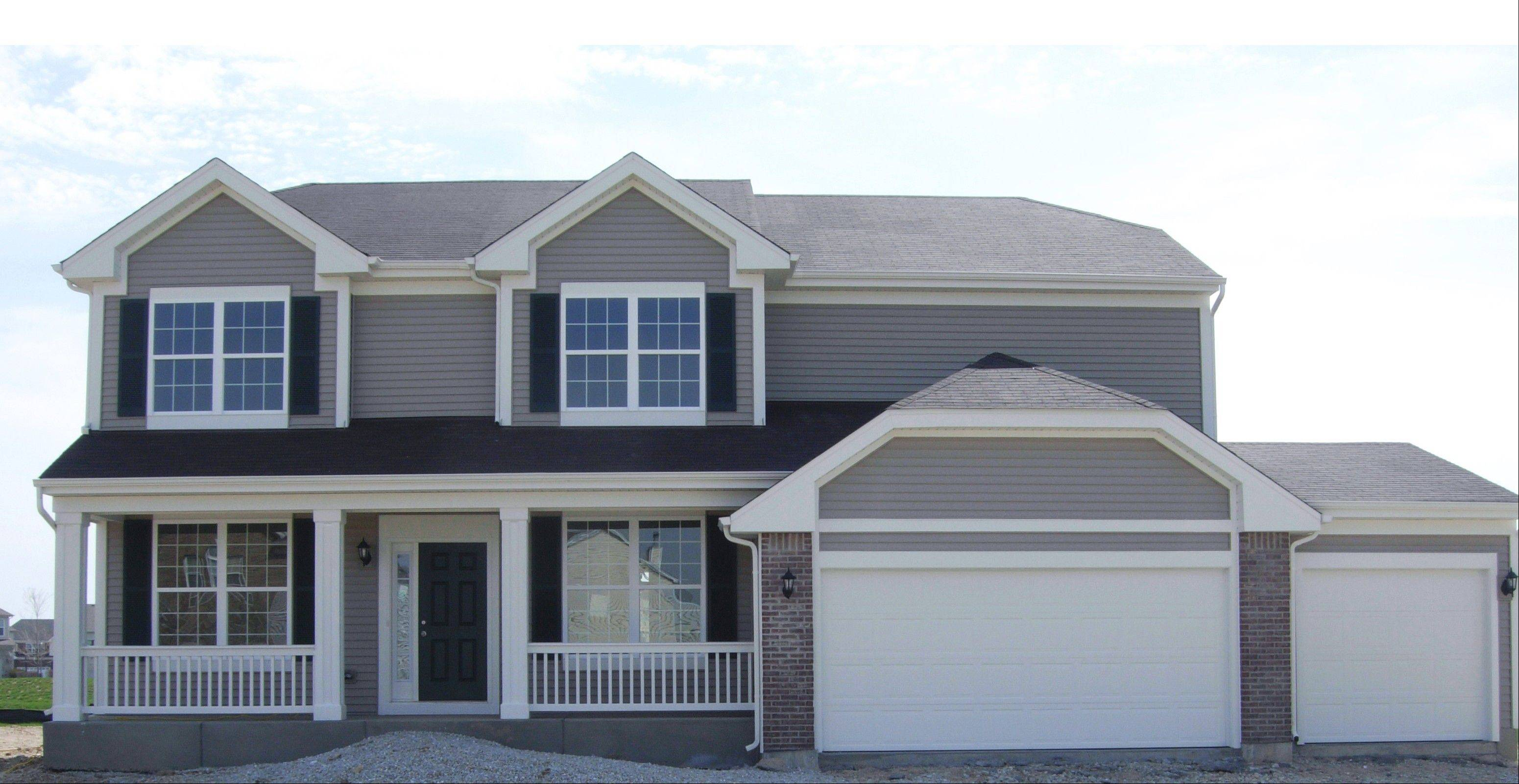 This Tuscan model is now ready for purchase at Cambridge at Southbury, a new home community in Oswego.