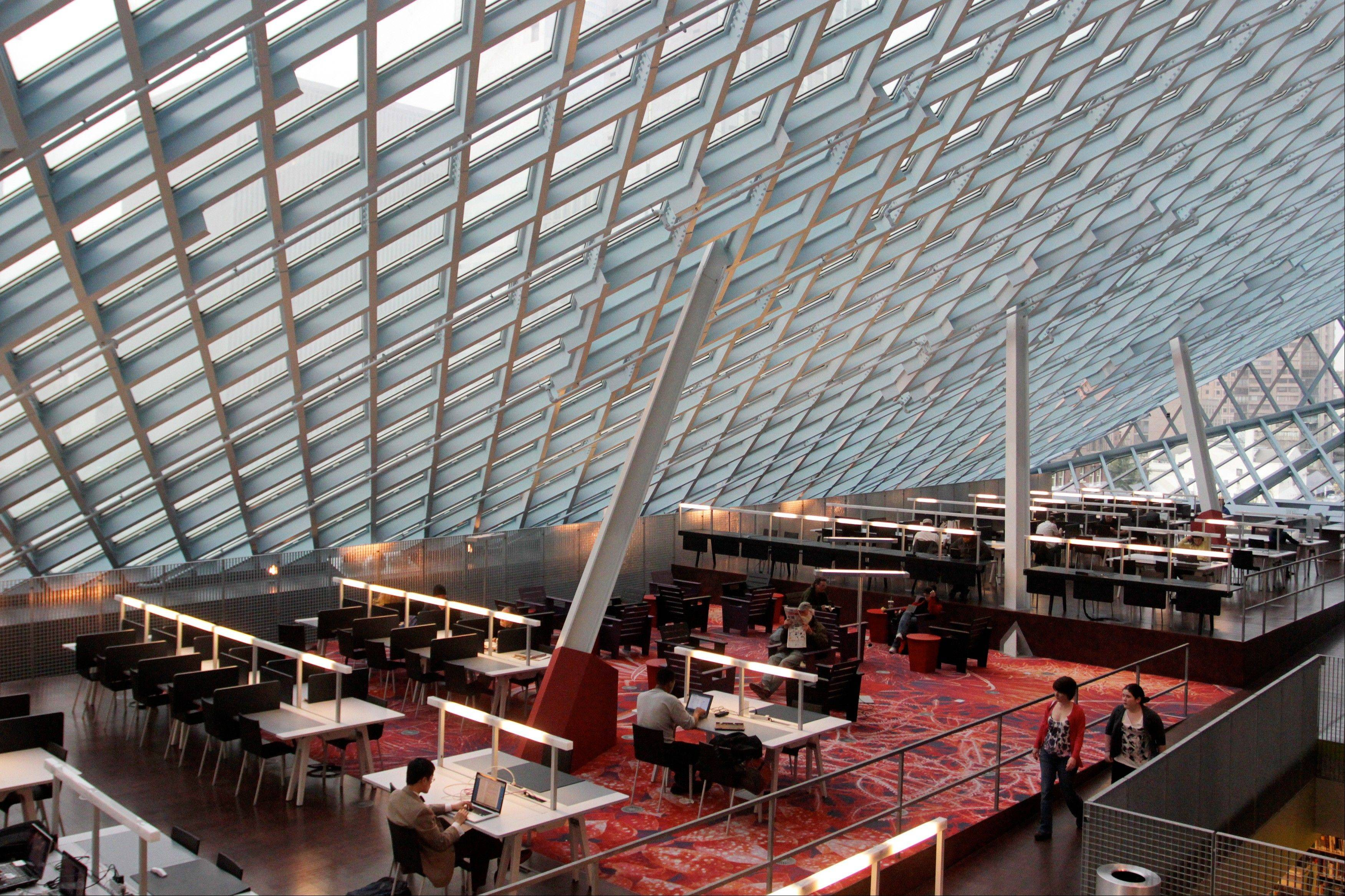 The interior of the Seattle Central Library. The $165 million building's unusual design and decoration attracts visitors from all over the world.