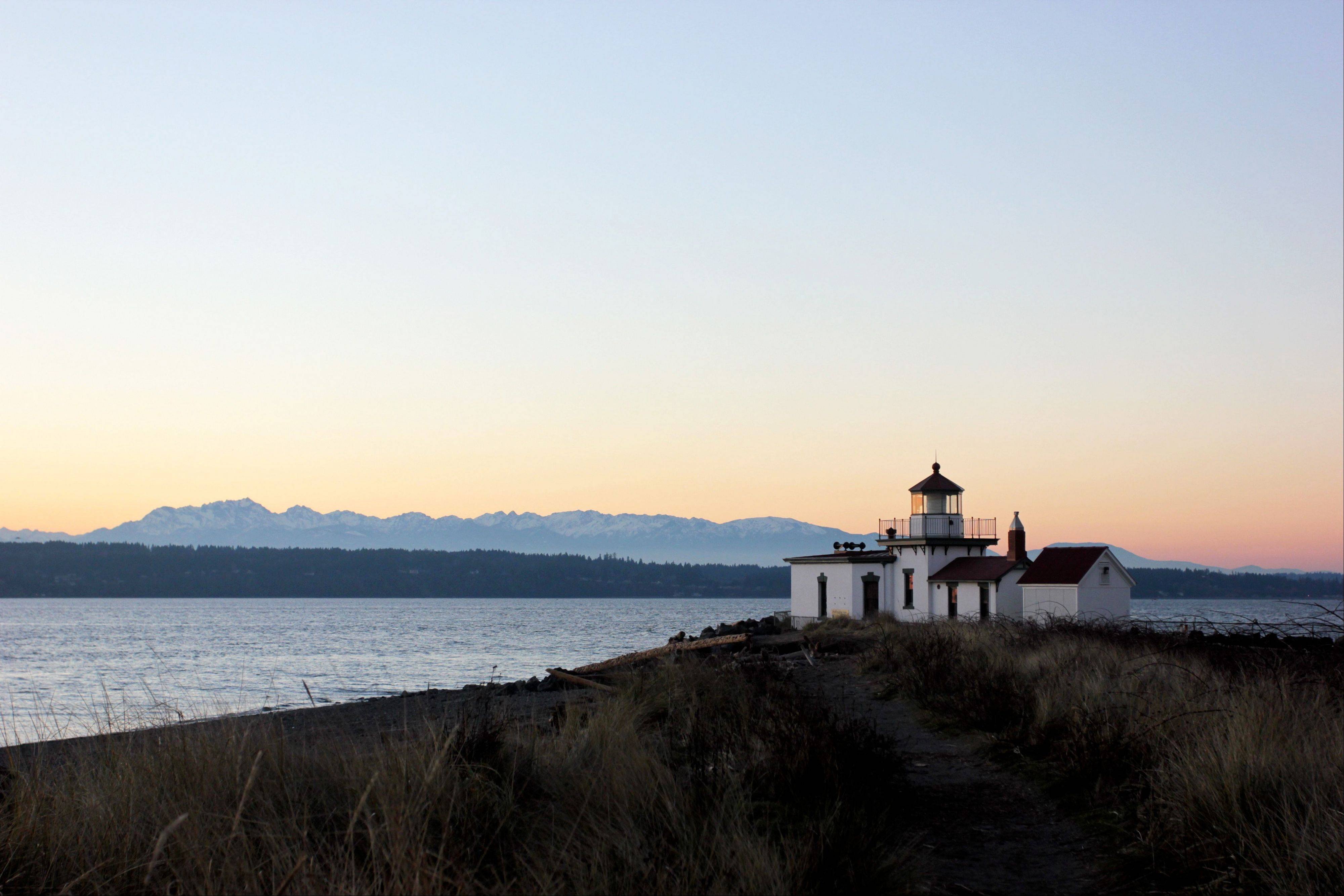A lighthouse lines the beach at Discovery Park in Seattle.