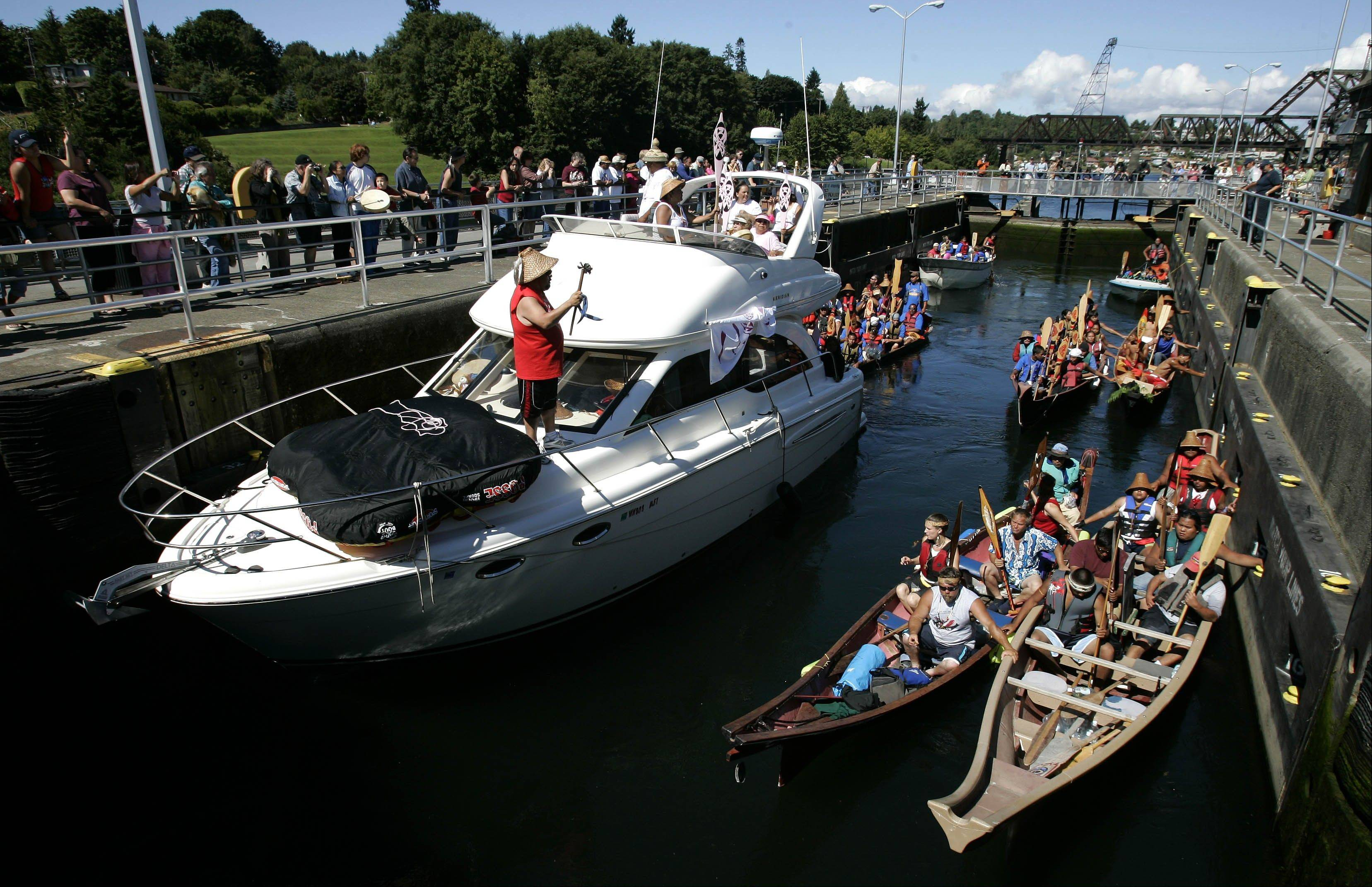 Boats and tribal canoes take part in the Tribal Journey in the Ballard Locks in Seattle. The Tribal Journey is held every year as a way to preserve Indian heritage and promote positive lifestyles for Indian youth.