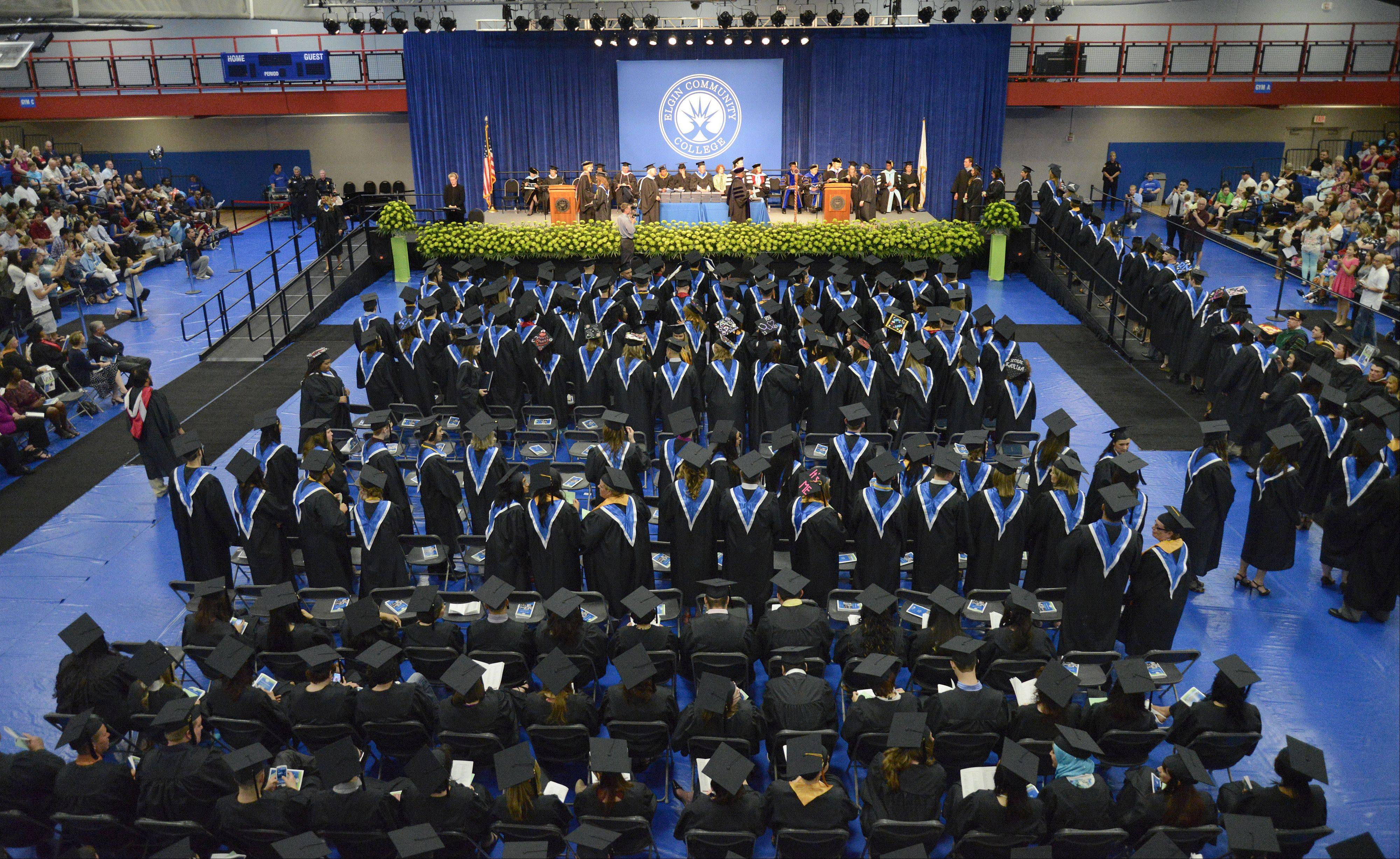 About 225 graduates receive their diplomas at Elgin Community College's afternoon commencement ceremony on Saturday.