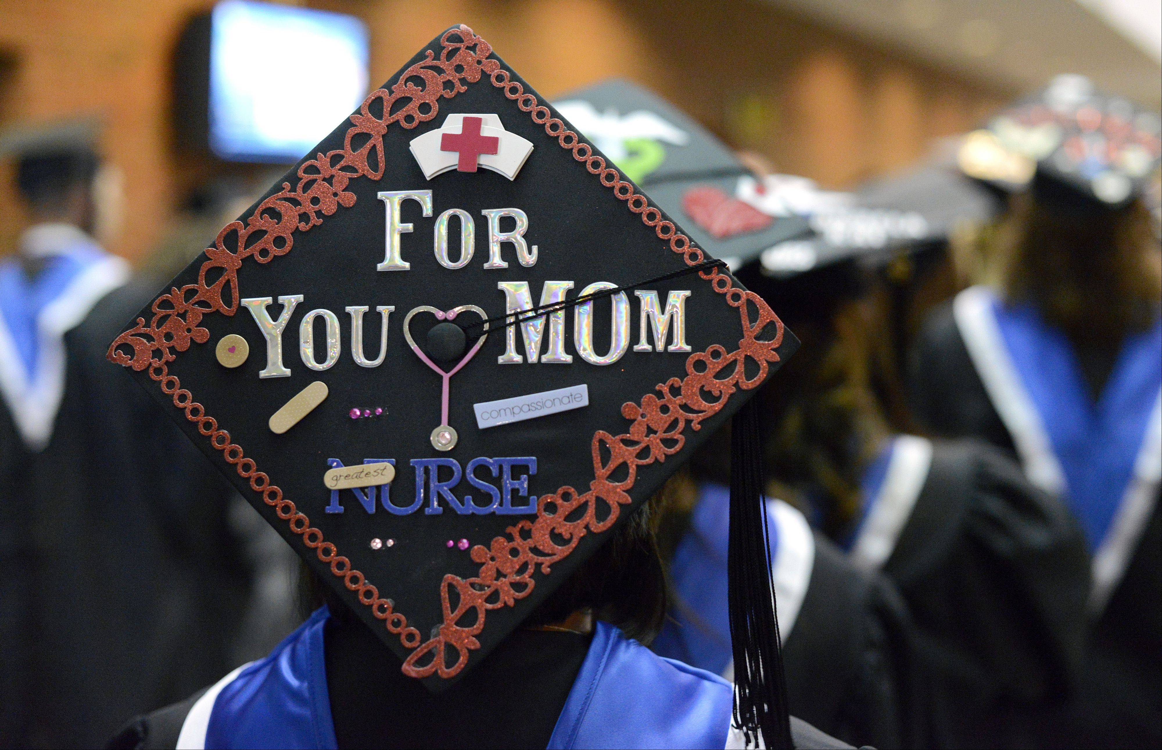 Rinah Ortega of Gilberts decorated her cap for her Elgin Community College graduation to honor her mother, who died recently. The commencement ceremony was on Saturday.