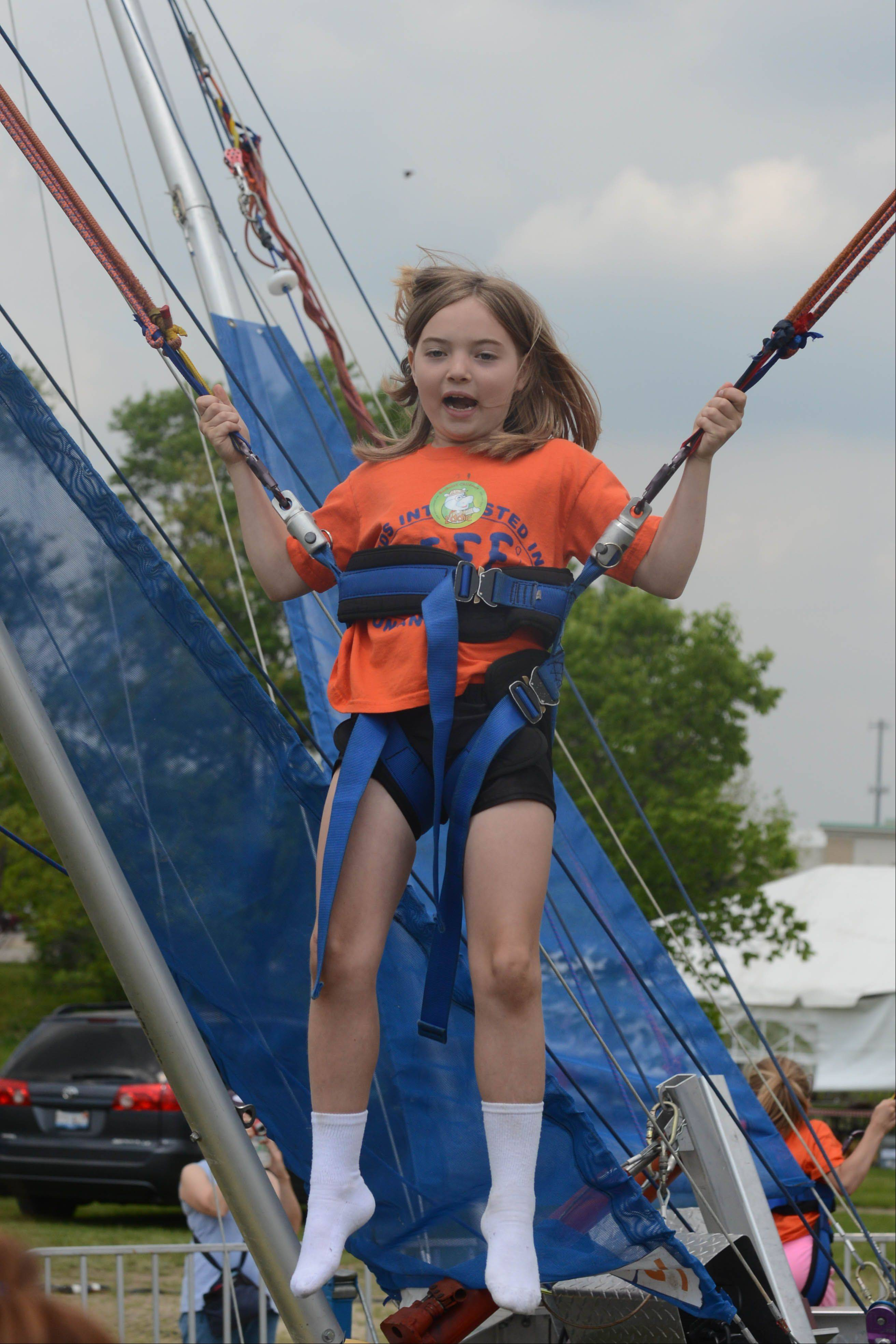 Maggie Nelson, 9, of Carol Stream rides the Eurobungy during the eighth annual JustPlay! Sports & Rec Festival in Carol Stream Saturday.