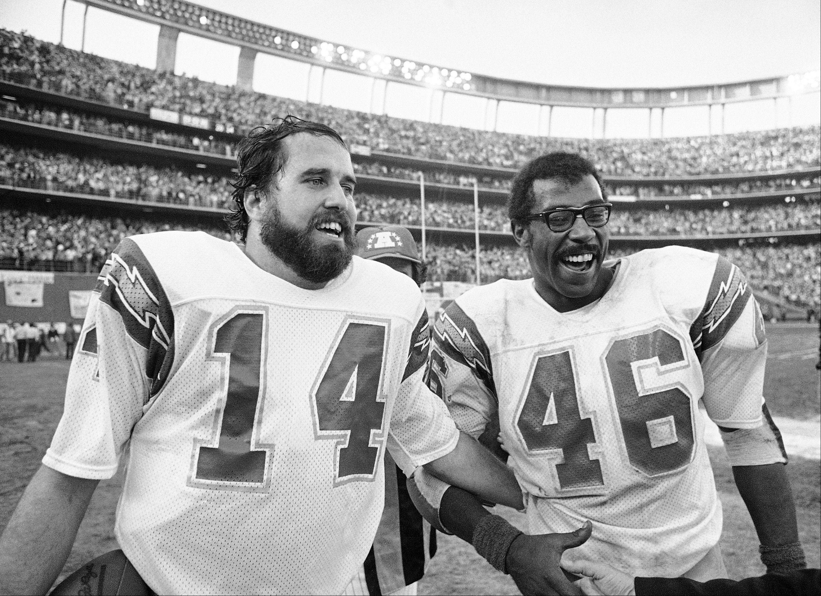San Diego Charges quarterback Dan Fouts (14) and running back Chuck Muncie (46) flash big smiles as they leave field following the Chargers 20-14 over the Buffalo Bills in an NFL football playoff game in San Diego.