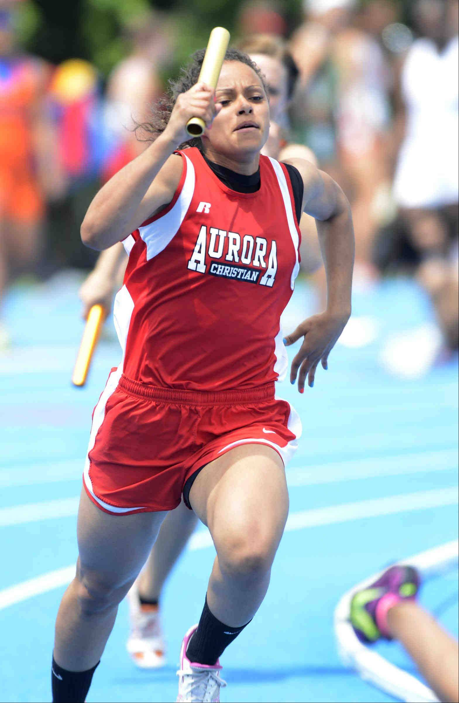 Aurora Christian's Alyssa Andersen runs the first leg of the 400 meter relay Saturday at the Class 1A girls state track and field finals at O'Brien Stadium at Eastern Illinois University in Charleston. They placed second.