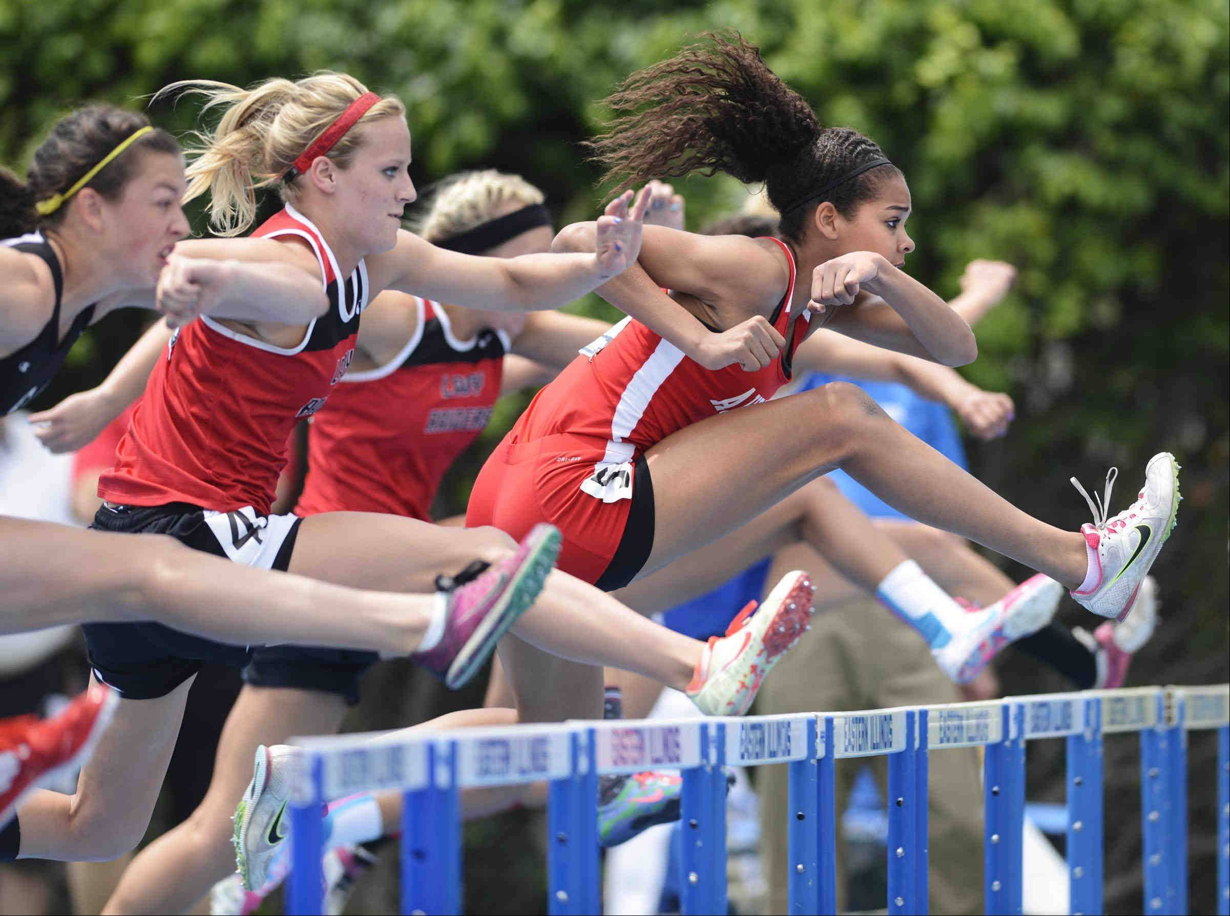 Aurora Christian's Peyton Wade leads the field over the first hurdle on her way to a state championship in the 100 meter high hurdles Saturday at the Class 1A girls state track and field finals at O'Brien Stadium at Eastern Illinois University in Charleston.