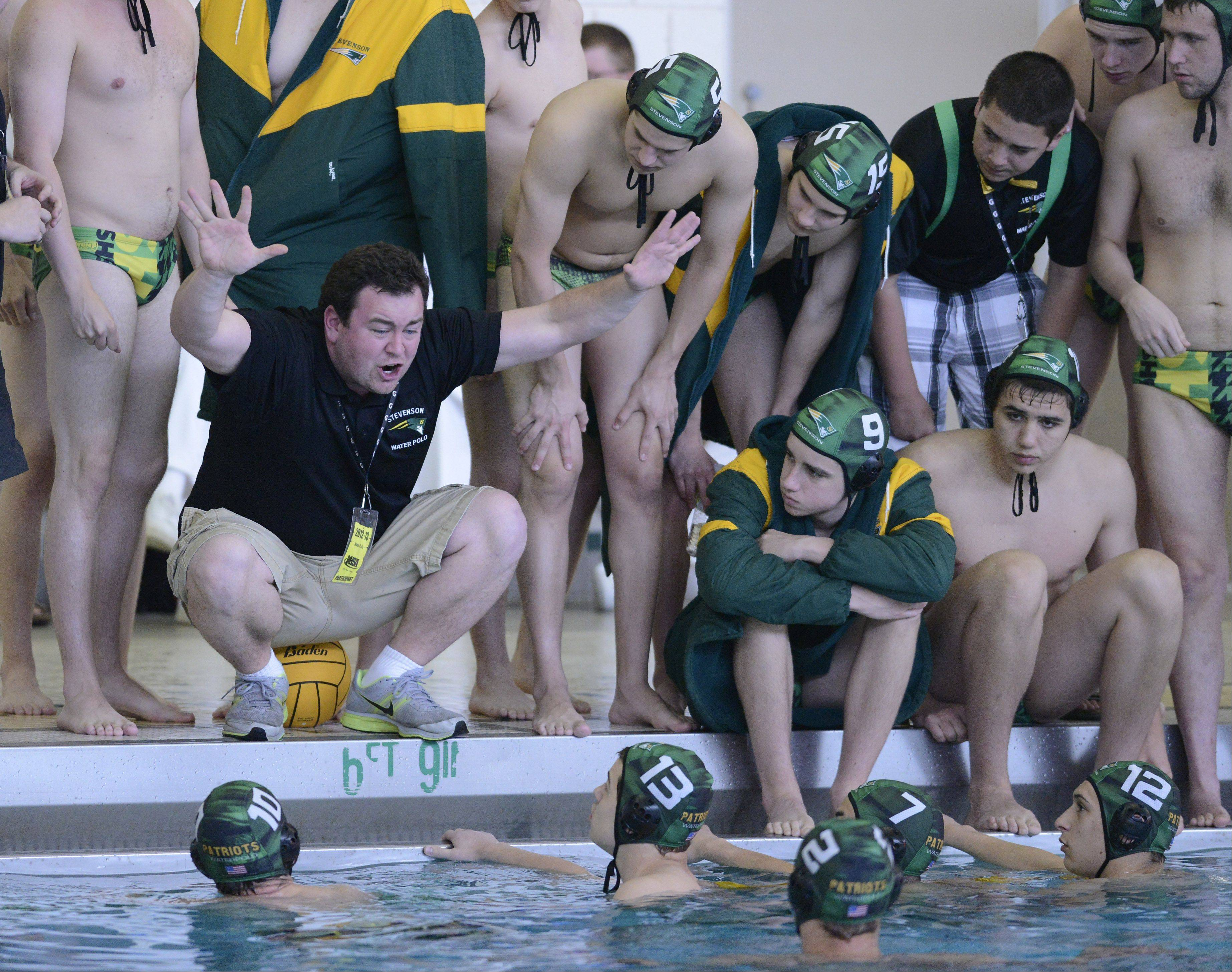 Stevenson coach Sean Wimer leads his team during the boys water polo state semifinal against St. Ignatius at Stevenson on Saturday.